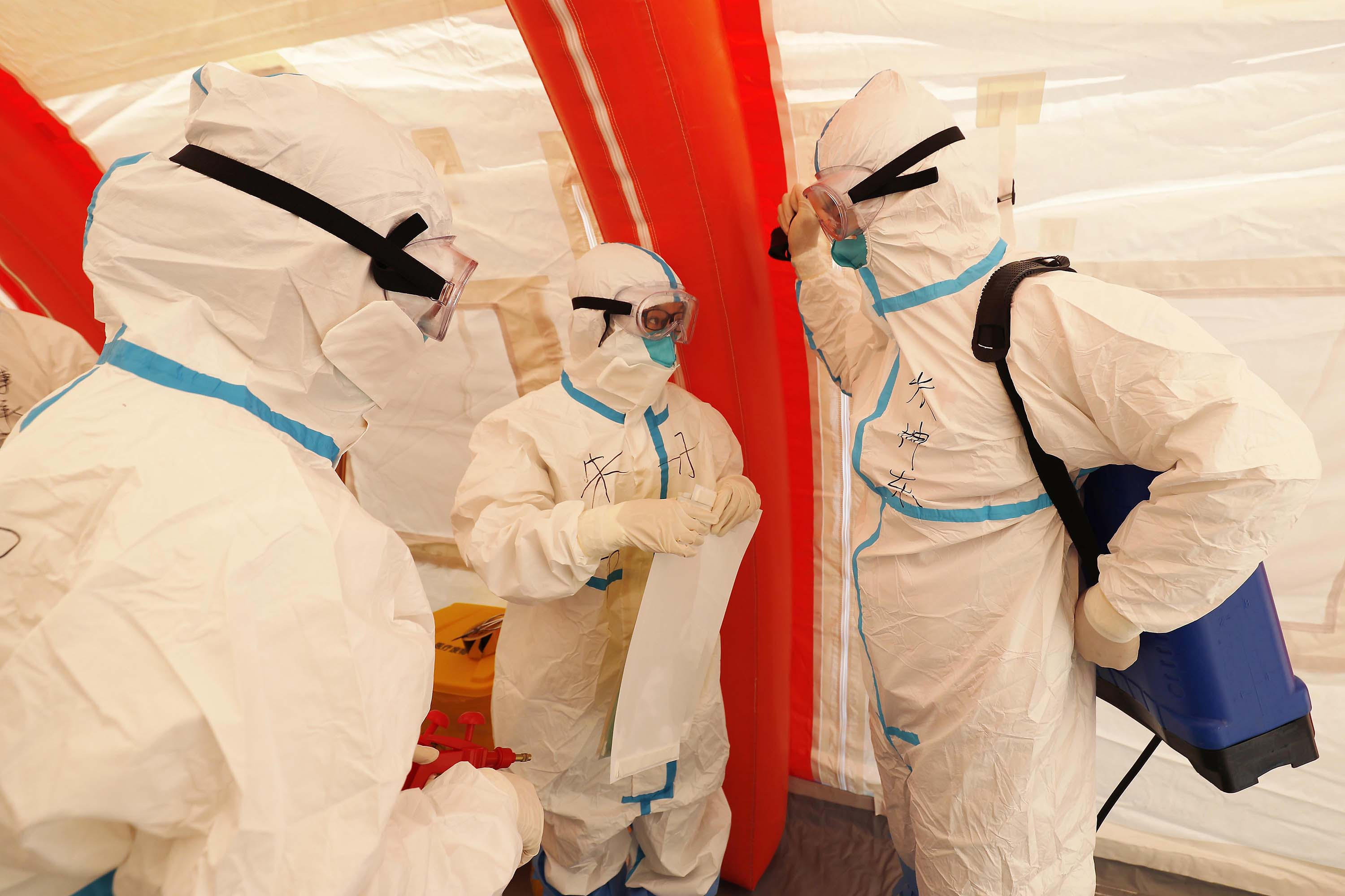Medical workers participate in a public health emergency drill at a hospital in Shanghai, on October 24.