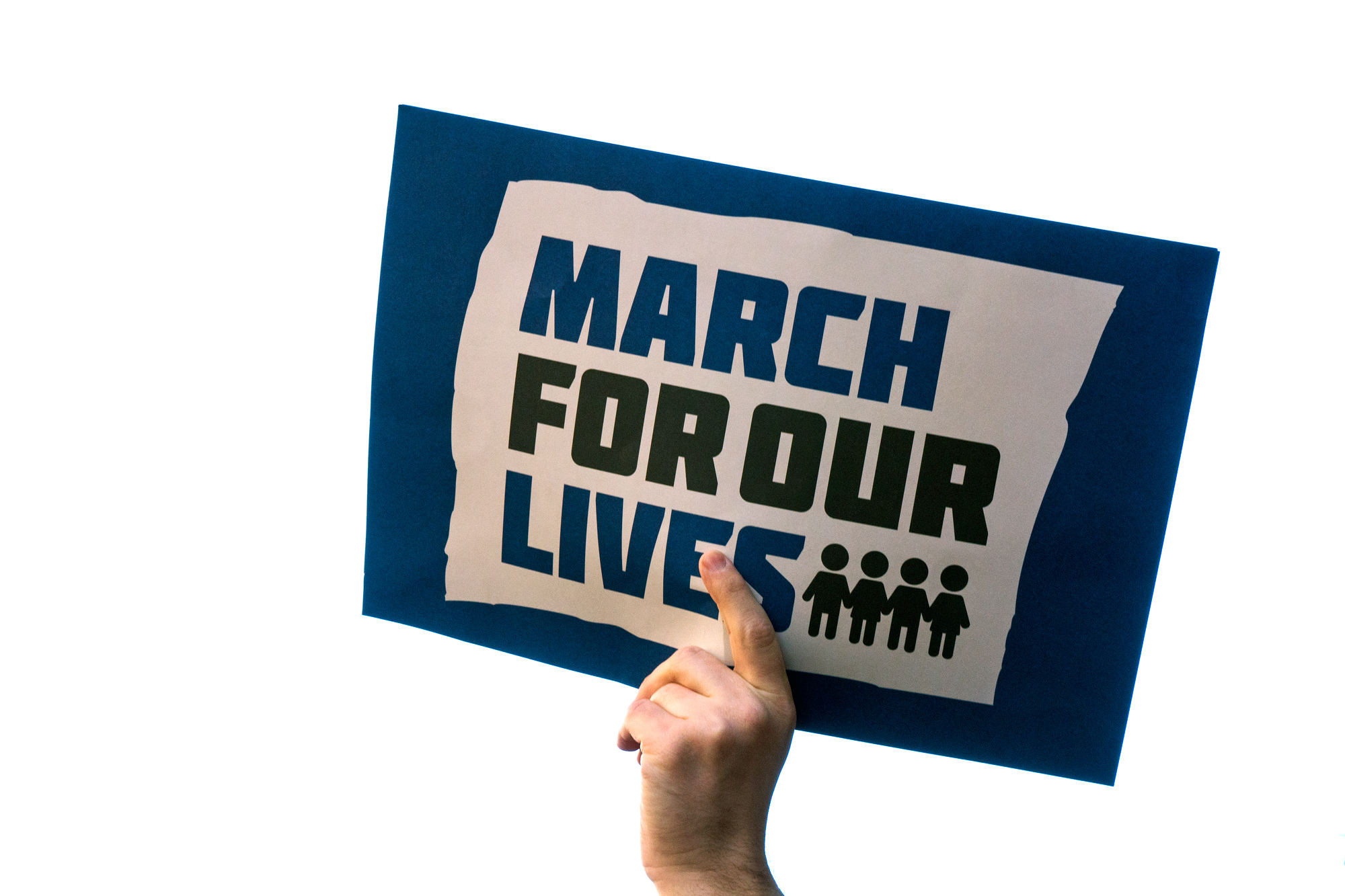 Demonstrators hold signs during the March For Our Lives on March 24, 2018 in New York City.