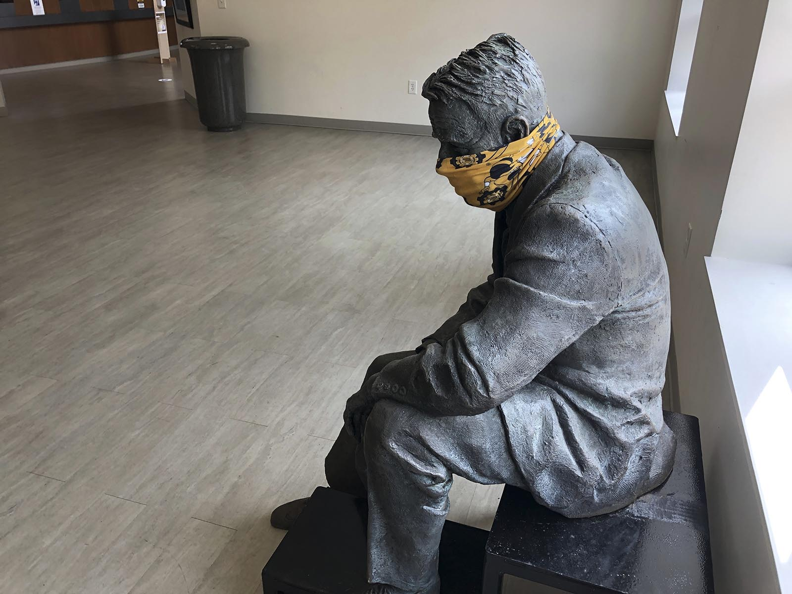 A statue is masked inside a building on the first day of classes Monday, August 17, at Georgia Tech in Atlanta.