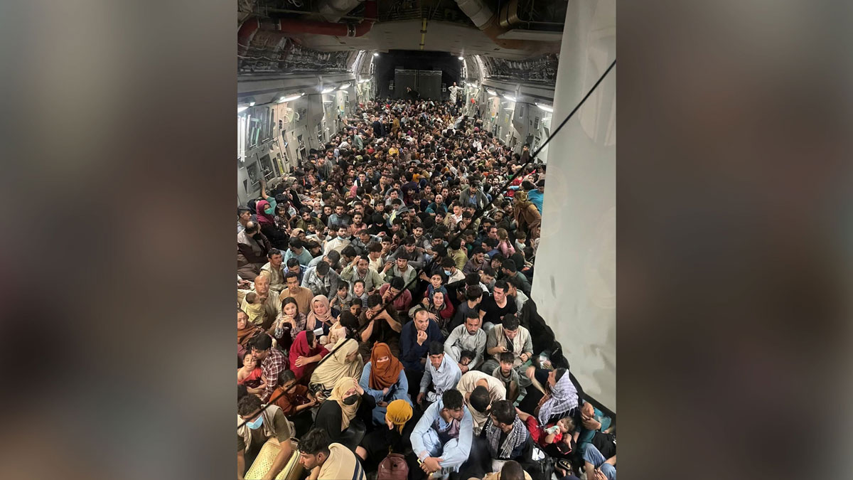 Evacuees crowd the interior of a U.S. Air Force C-17 Globemaster III transport aircraft, carrying some 640 Afghans to Qatar from Kabul, Afghanistan on August 15.