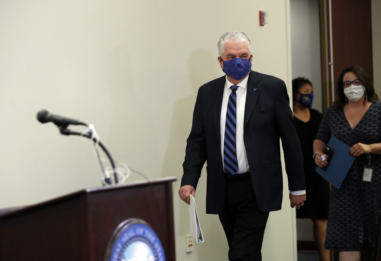 Nevada Governor Steve Sisolak arrives for a news conference at the Grant Sawyer State Building in Las Vegas, on Tuesday, September 29.