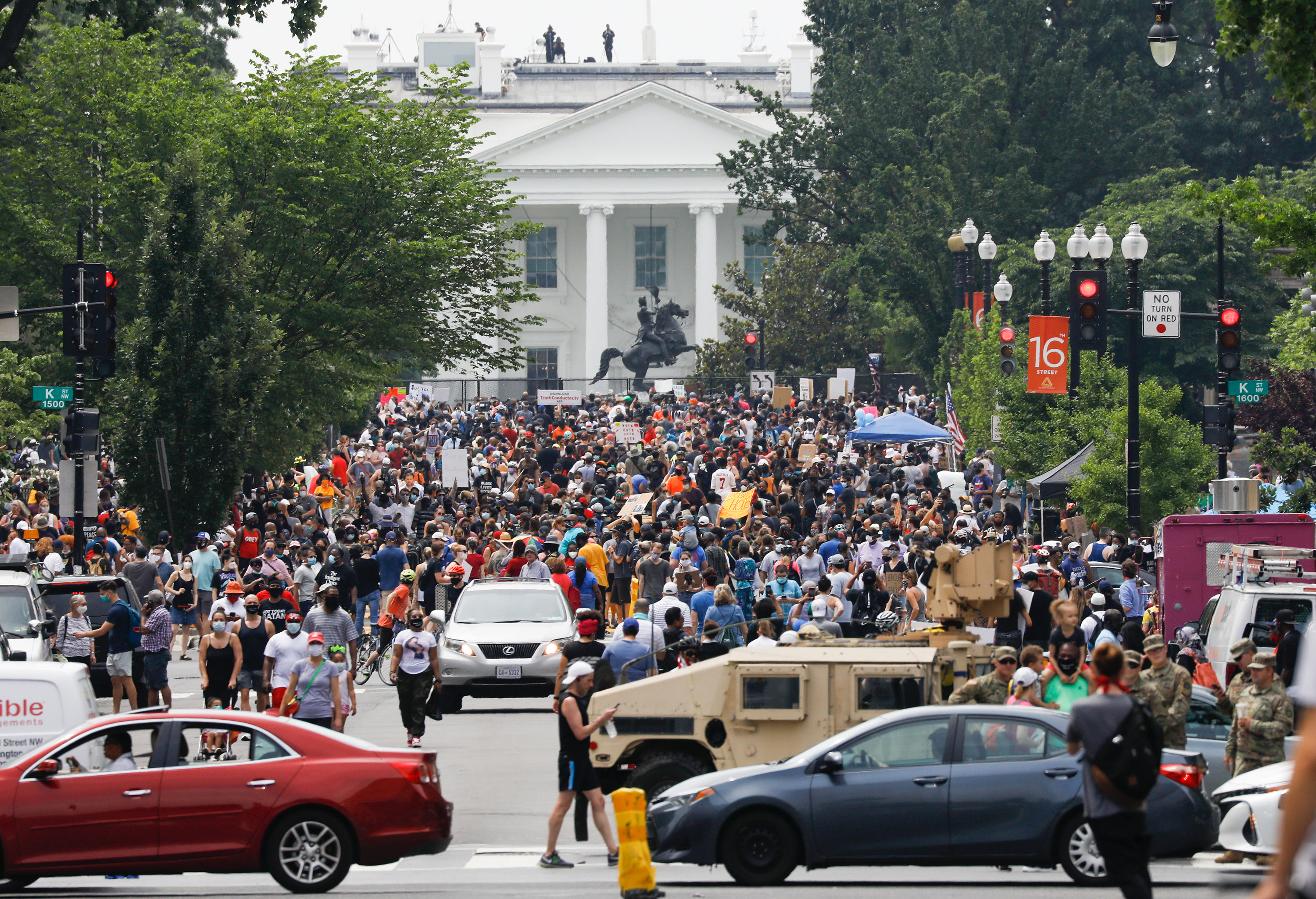 Demonstrators protest on 16th Street near the White House in Washington on Saturday, June 6.
