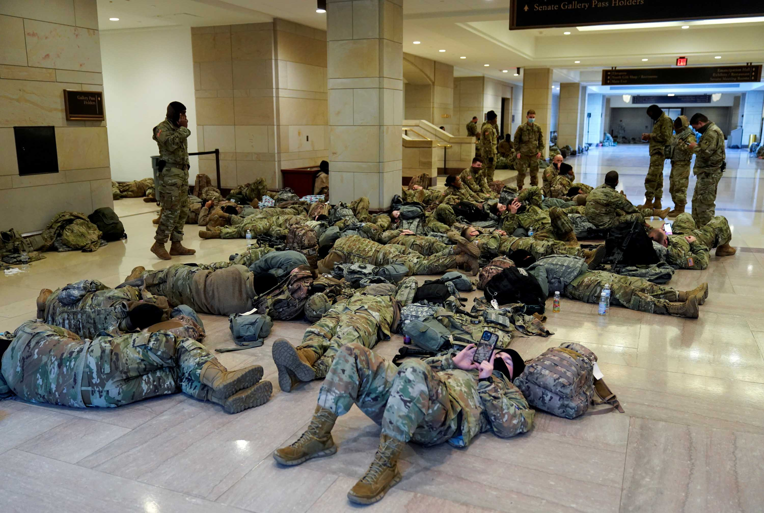 National Guard members rest in the Capitol Vistor's Center, ahead of the debate on impeachment against US President Trump on January 13.