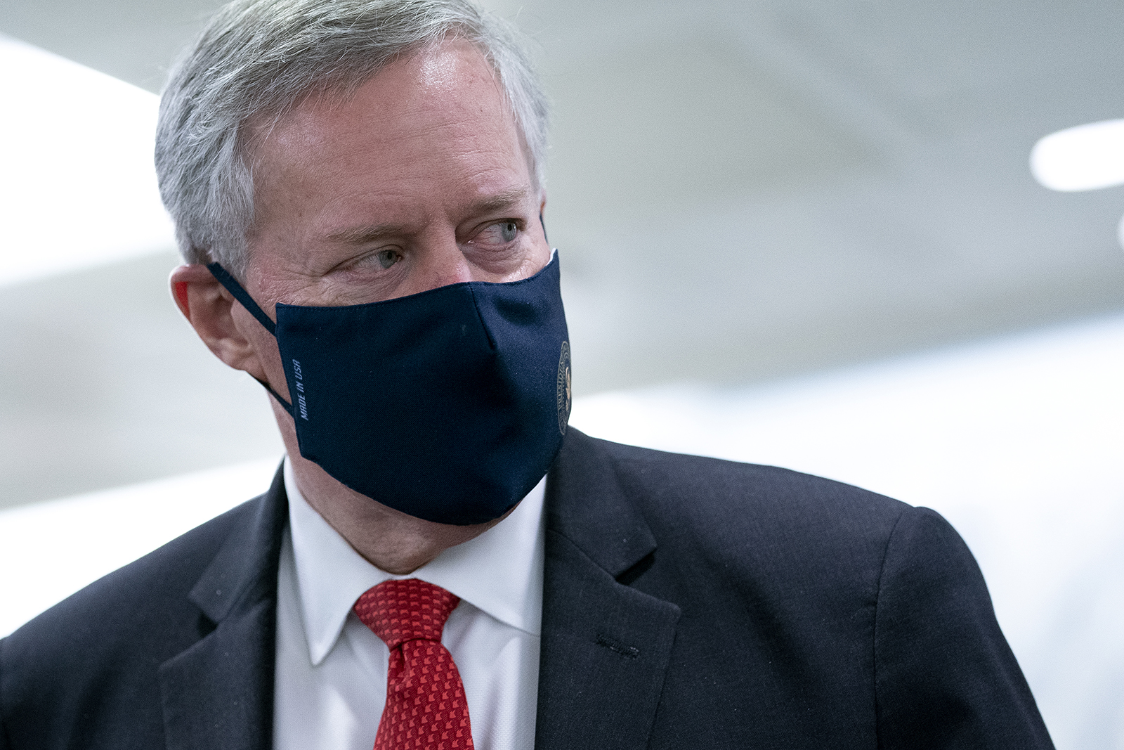 White House Chief of Staff Mark Meadows wears a protective mask as he departs the Senate Republican policy luncheon in the Hart Senate Office Building on Capitol Hill on October 21 in Washington.