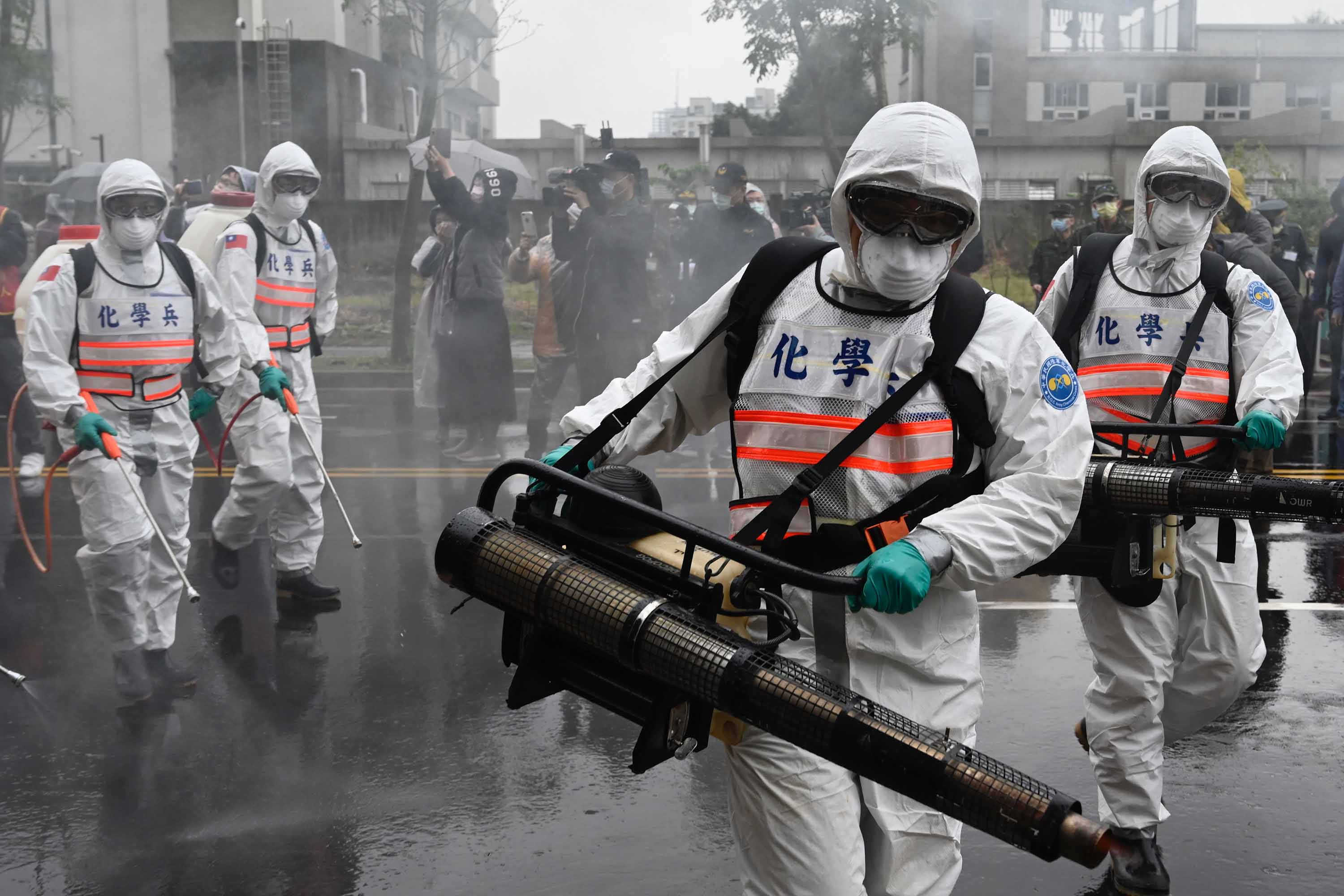Members of Taiwan's military take part in a drill to prevent the spread of the coronavirus, in New Taipei City on March 14.