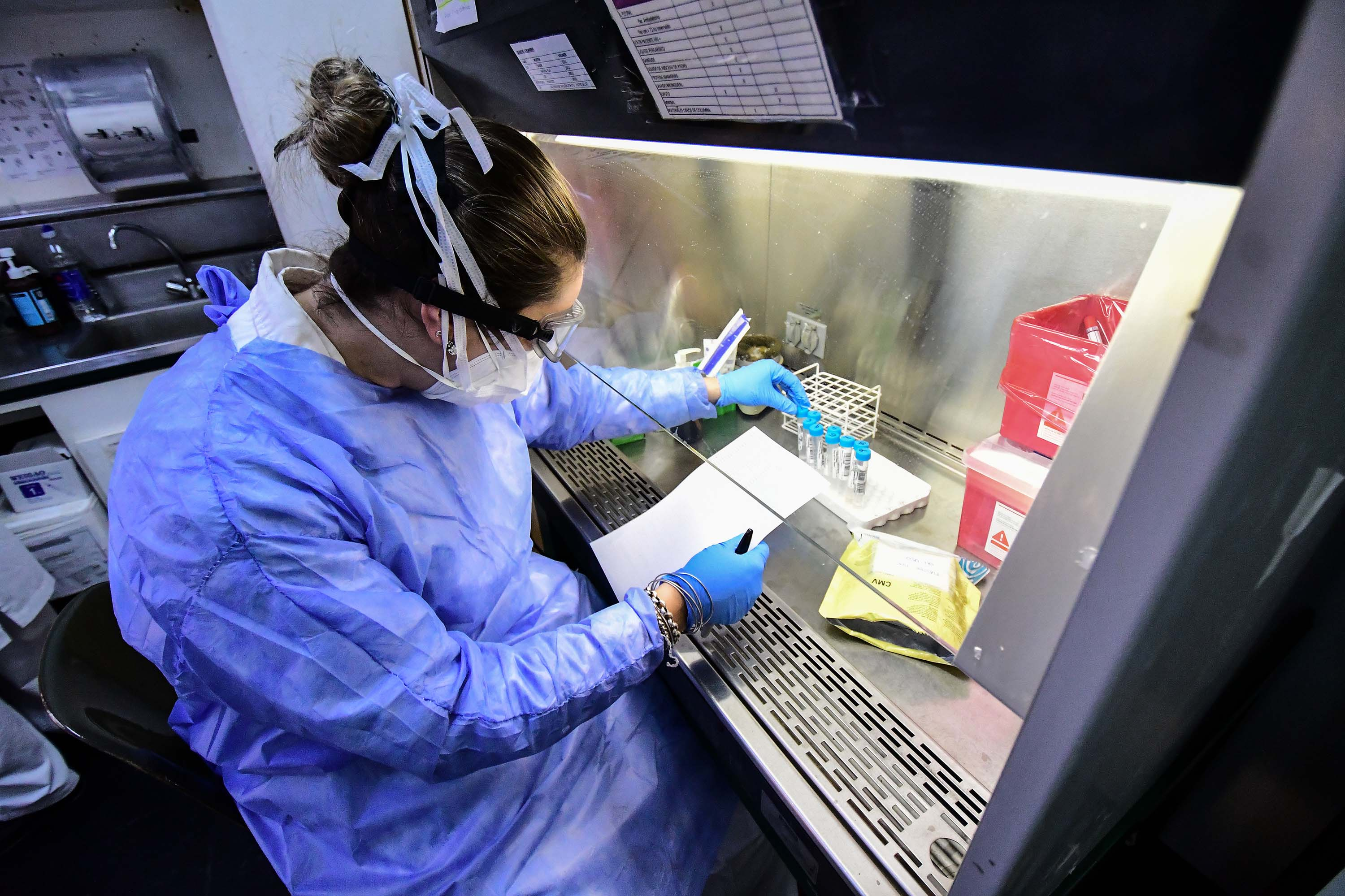 Guillermina Maglione manipulates swab samples to make a real time polymerase chain reaction analysis for COVID-19 testing at the biochemistry lab of Central Navy Hospital Dr. Pedro Malloon on April 28, in Buenos Aires, Argentina.