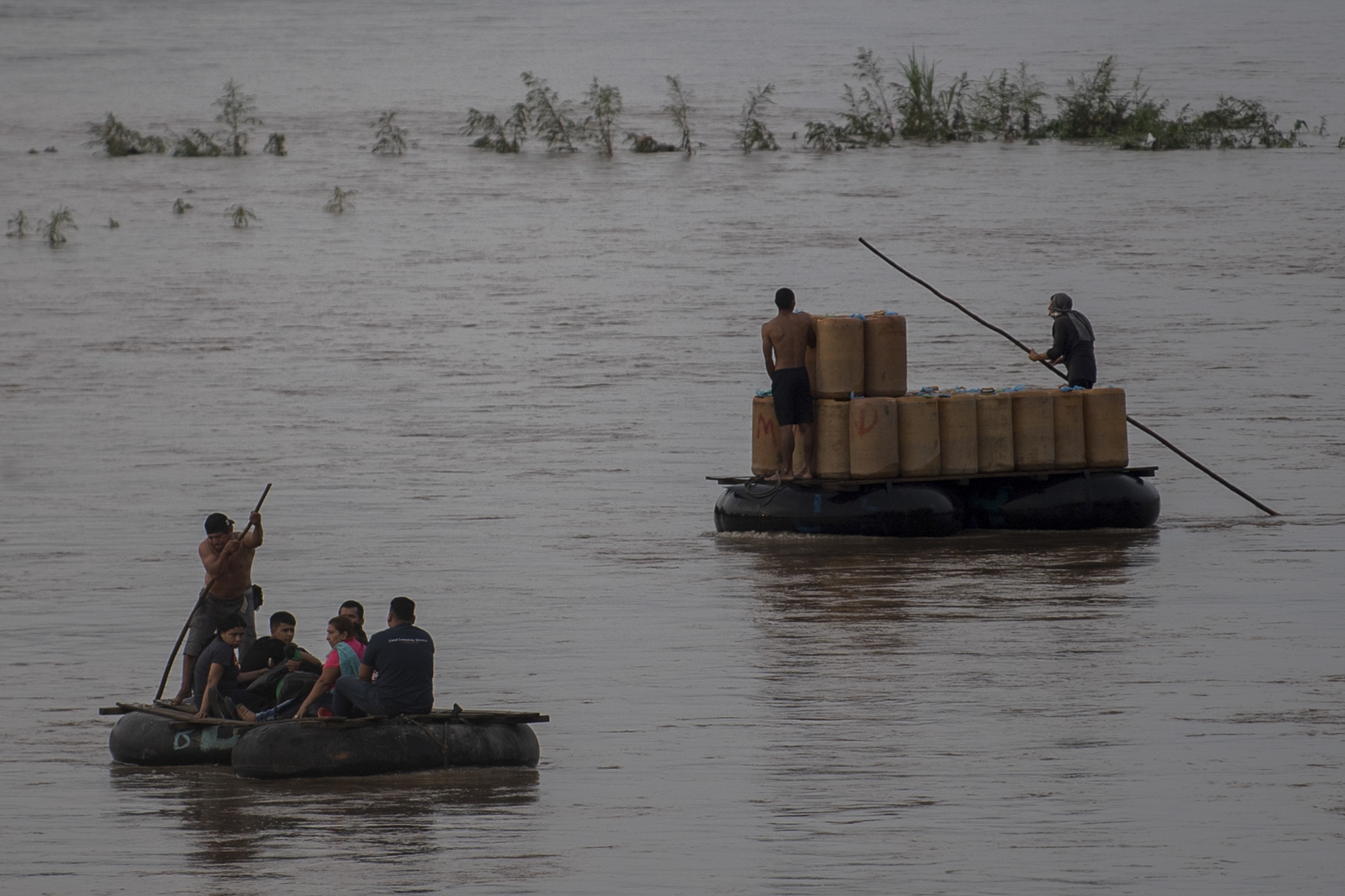 Locals use a makeshift raft to illegally cross the Suchiate river from Ciudad Hidalgo in Chiapas State, Mexico, to Tecun Uman in Guatemala, on June 10, 2019.