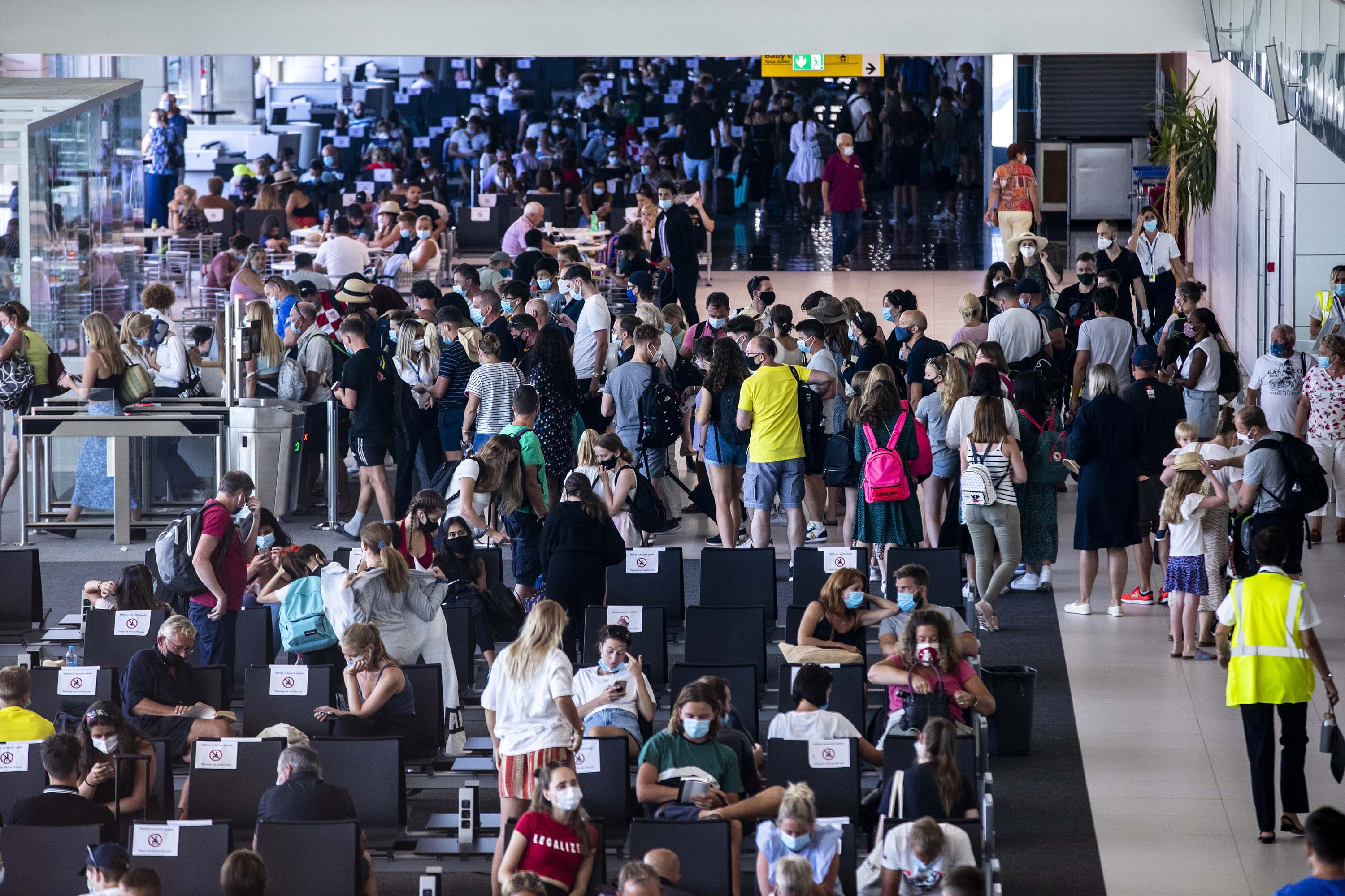 """People are seen at Split International Airport after the United Kingdom removed Croatia from a list of """"safe countries"""" to travel on August 20, due to the rising number of cases throughout the country."""