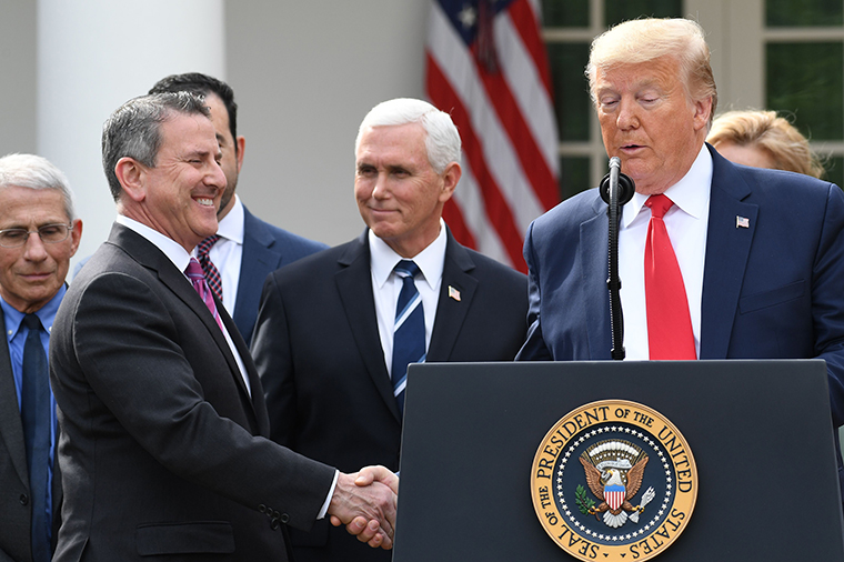 Brian Cornell, Chairman and CEO of Target Corporation shakes hands with US President Donald Trumpon Friday, March 13.