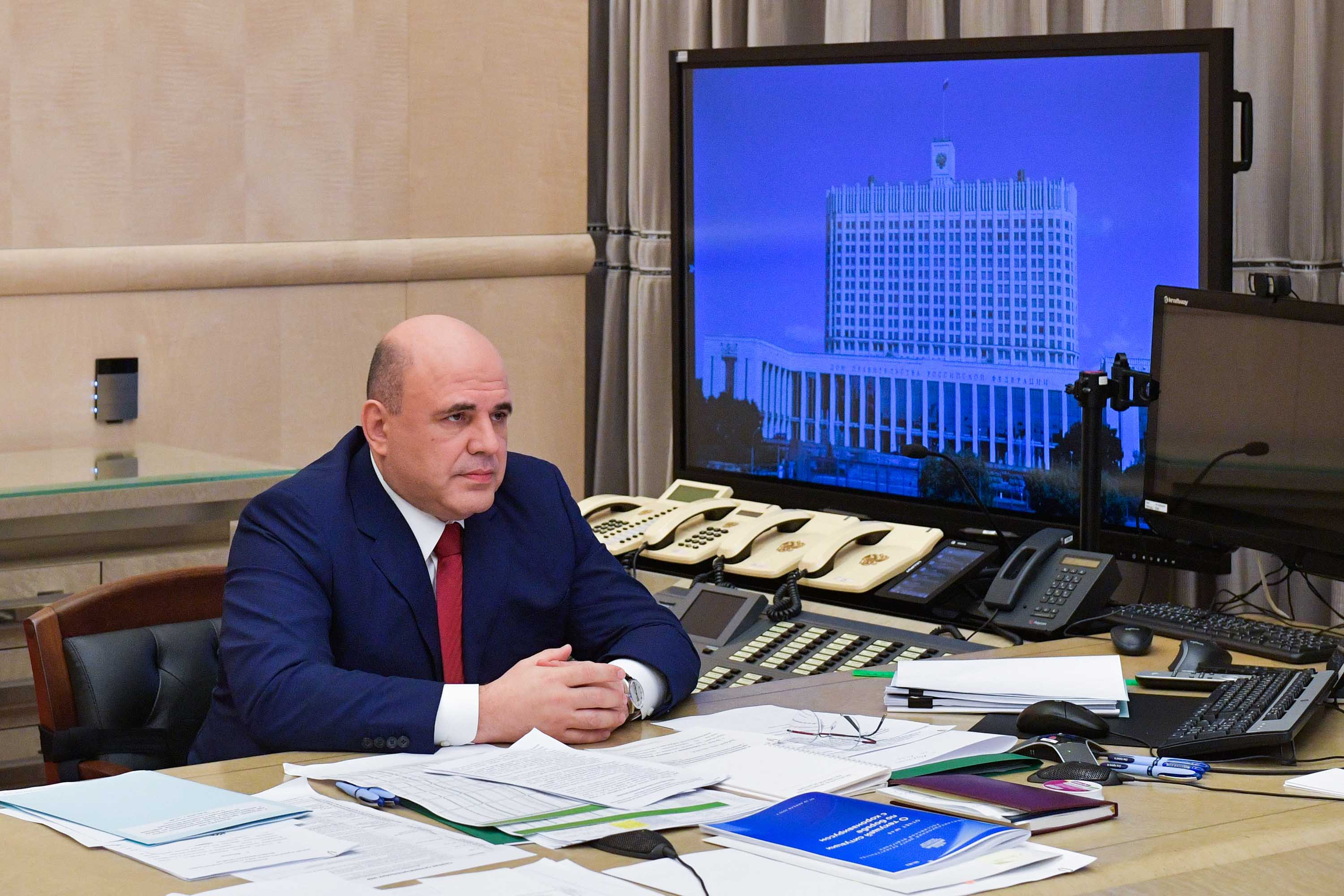 Russia's Prime Minister Mikhail Mishustin chairs a meeting via video link in Moscow on April 29.