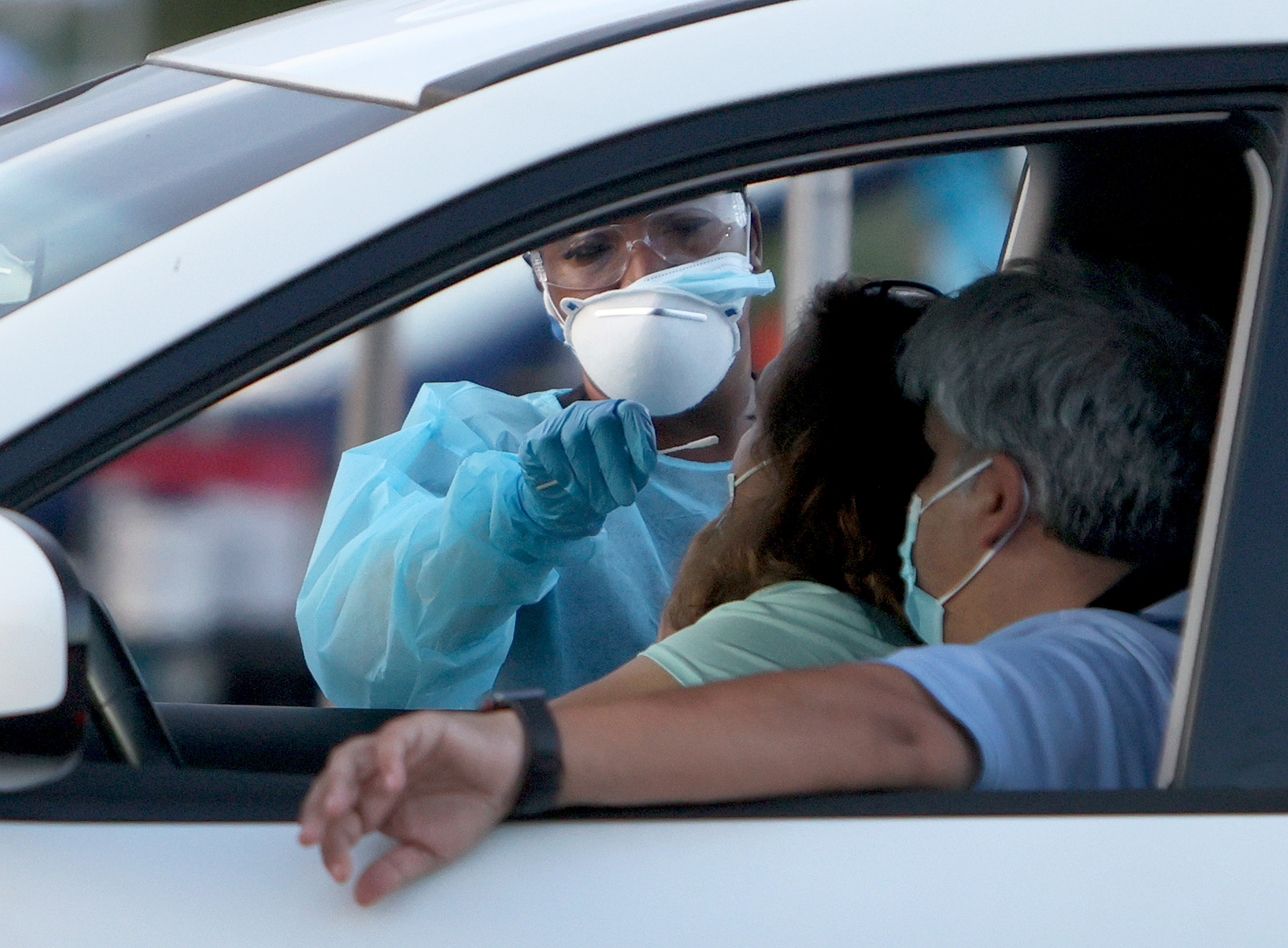A healthcare worker administers a Covid-19 test on August 30, in Miami, Florida.