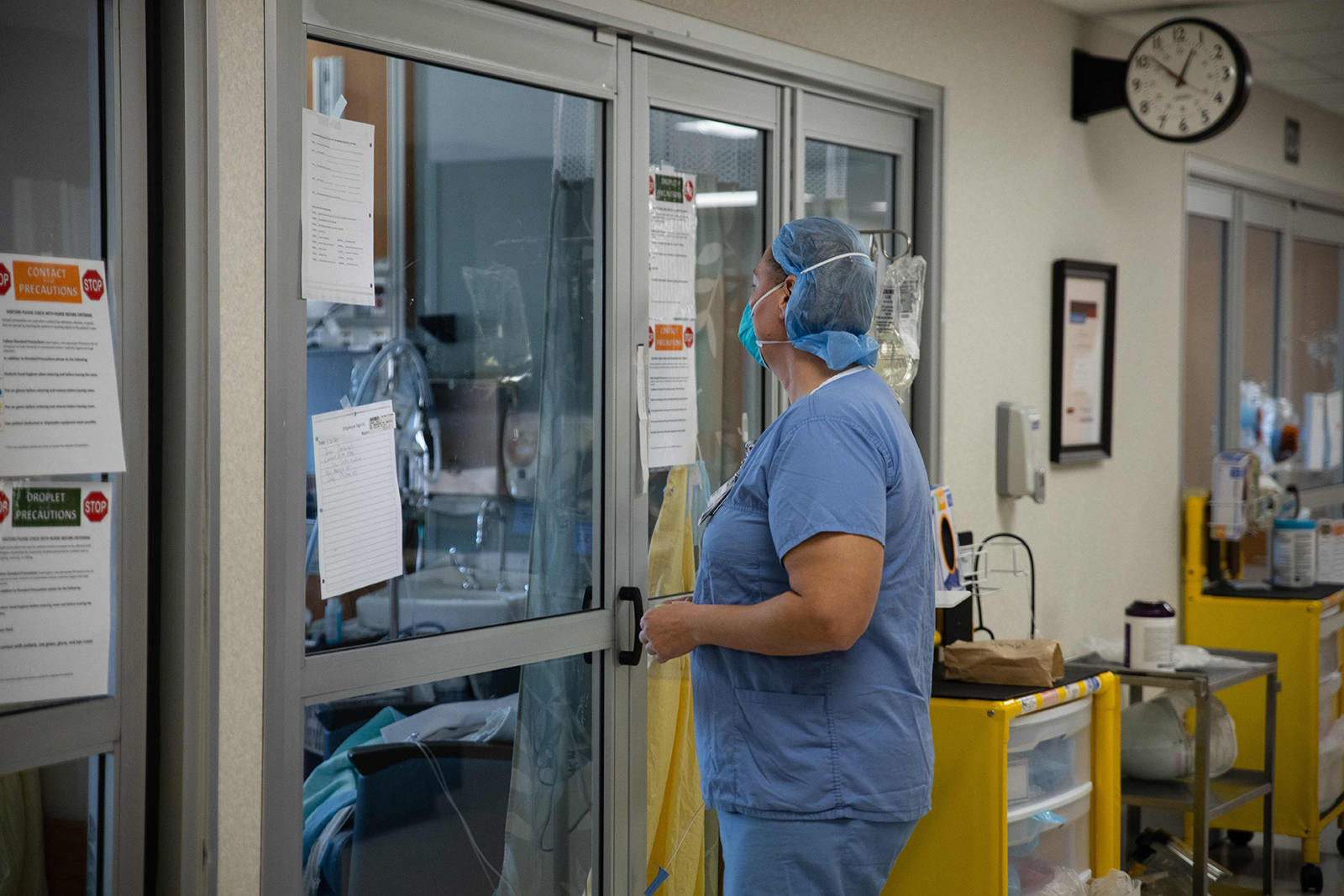 A health care worker prepares to enter a Covid-19 patient's room in the ICU at Van Wert County Hospital in Van Wert, Ohio on Nov. 20.