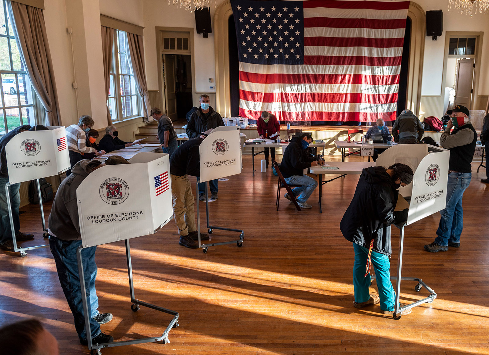 Voters cast their ballots at the old Stone School, used as a polling station, on election day in Hillsboro, Virginia on Tuesday.