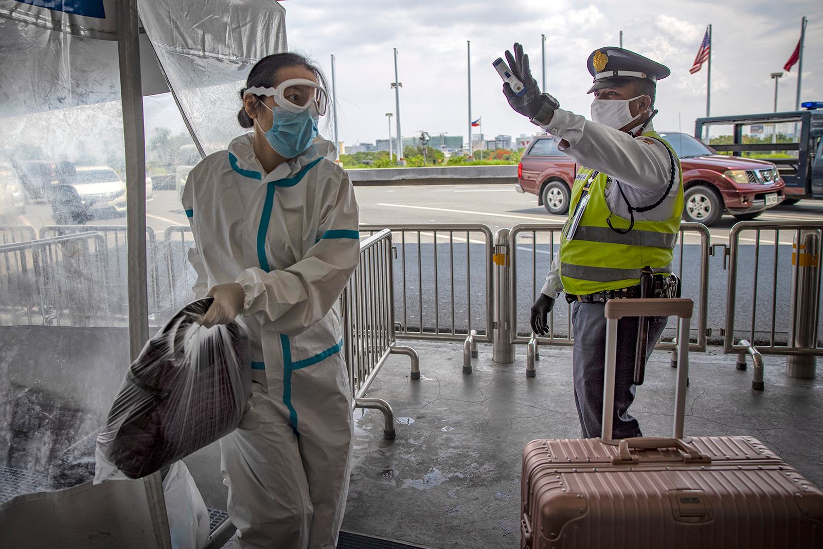 A traveler is seen wearing a protective suit upon arriving at Ninoy Aquino International Airport after a limited number of flights have resumed following relaxed lockdown measures on Friday, May 22, in Manila.