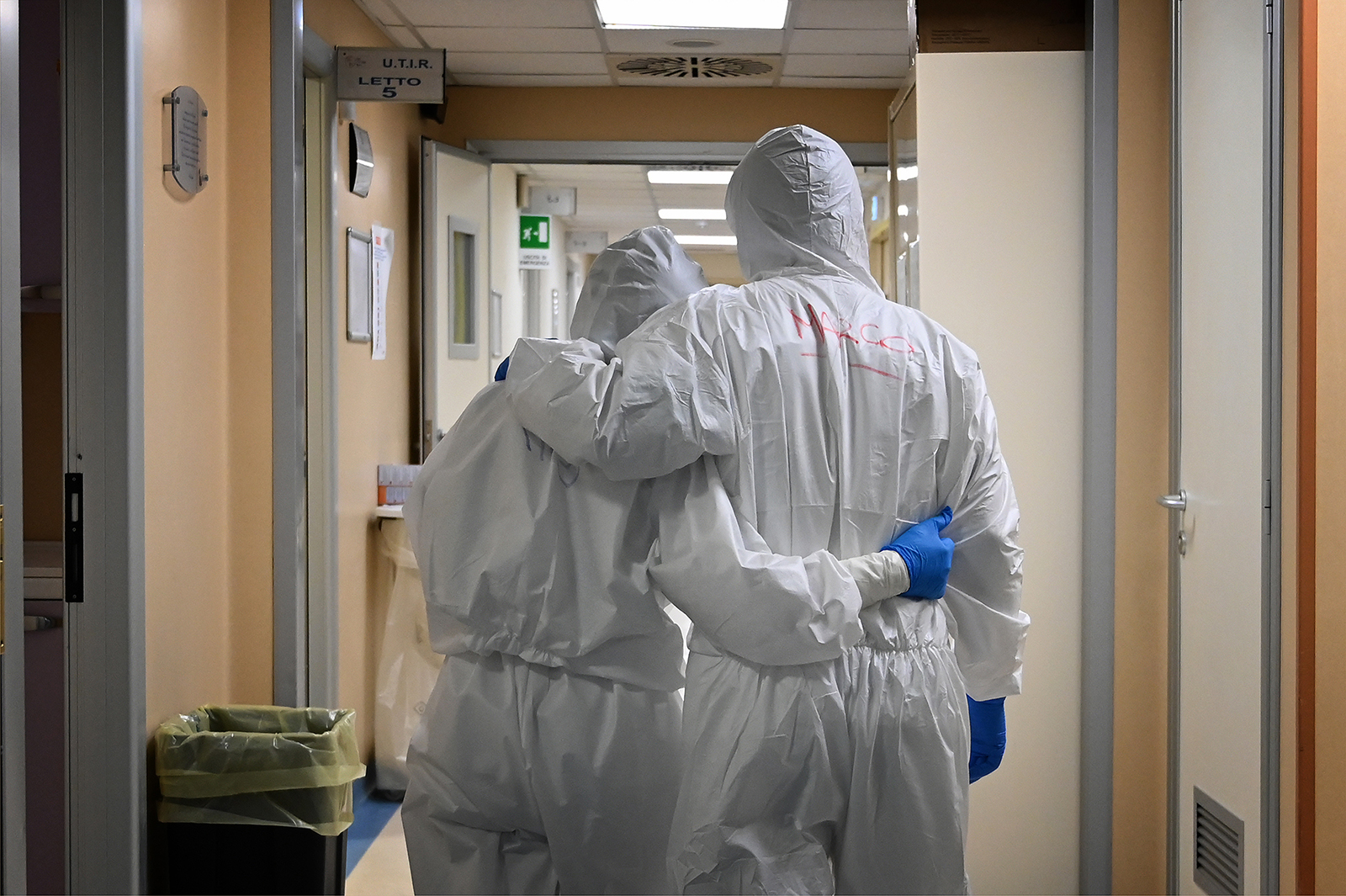 A doctor and nurse embrace at the end of their shift in the intensive care unit treating Covid-19 patients, at the San Filippo Neri hospital in Rome, on April 20.