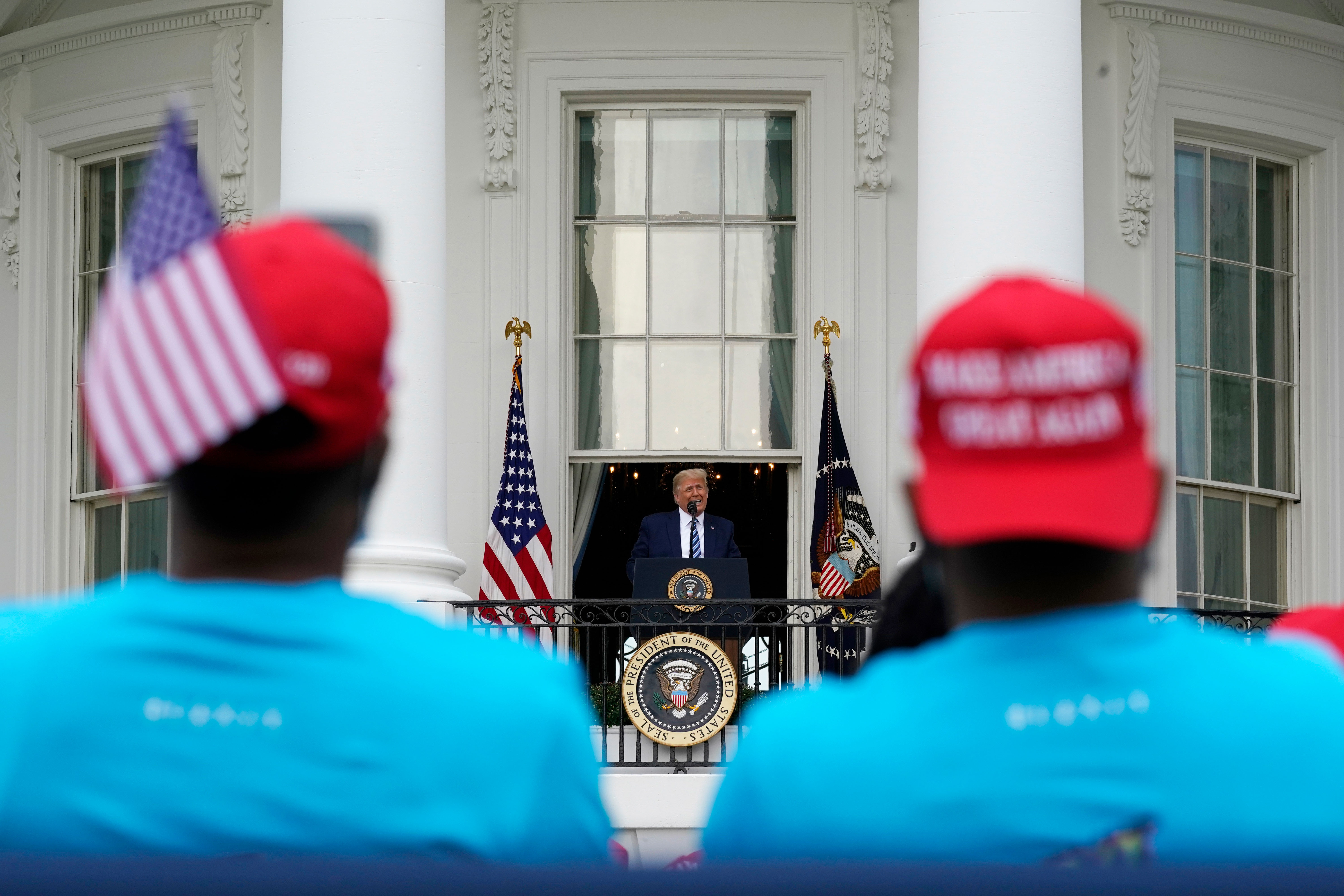 President Donald Trump speaks to supporters at the White House on October 10.