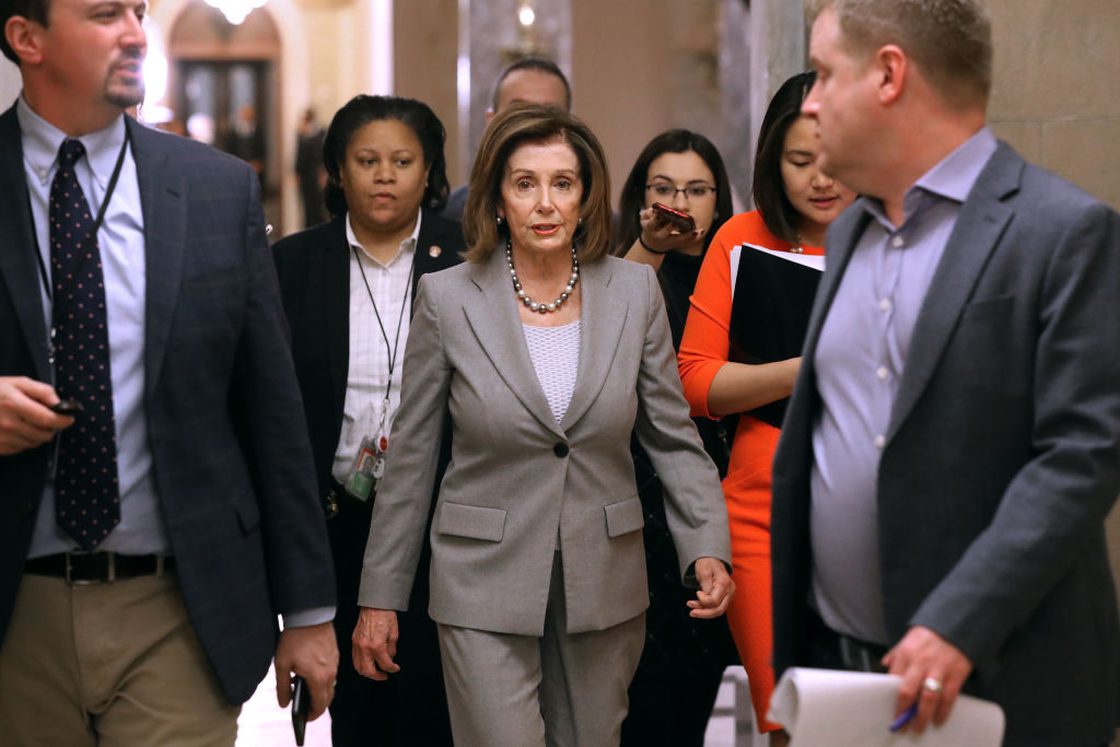 Speaker of the House Nancy Pelosi walks back to her office after leaving the House Chamber at the U.S. Capitol.