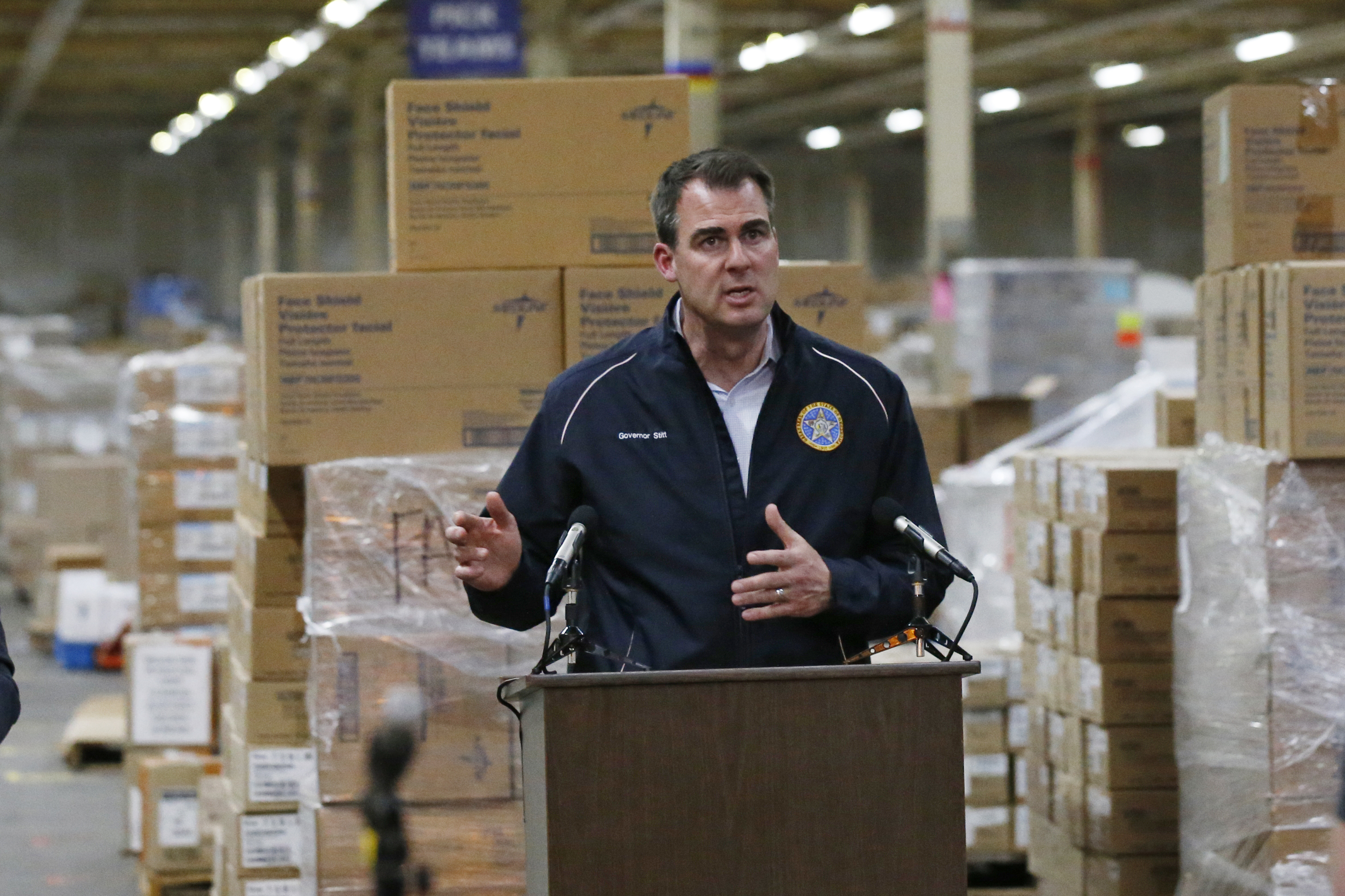 Oklahoma Gov. Kevin Stitt answers questions during a news conference at Oklahoma's Strategic National Stockpile warehouse in Oklahoma City on April 7.
