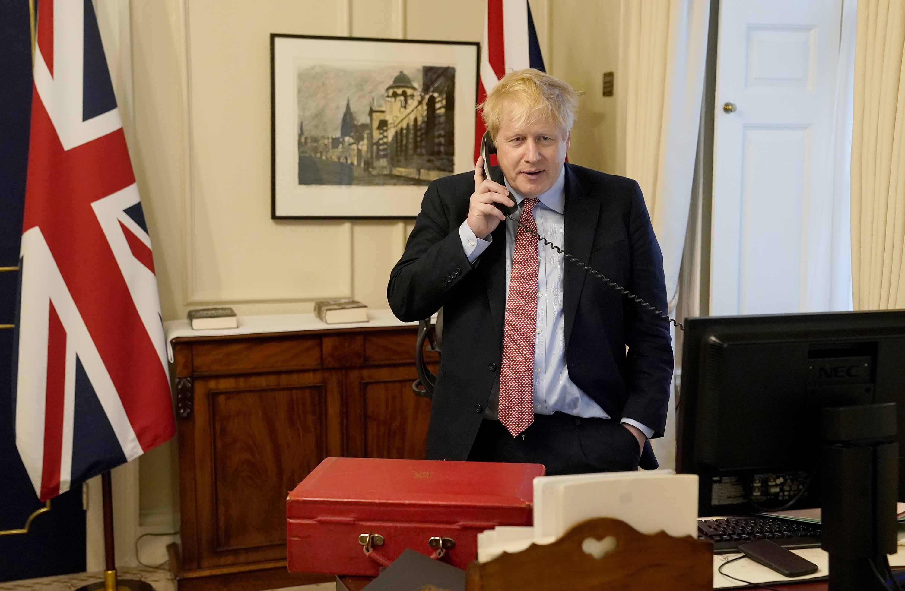 Prime Minister Boris Johnson speaks to Queen Elizabeth II on the phone during their Weekly Audience on March 25.