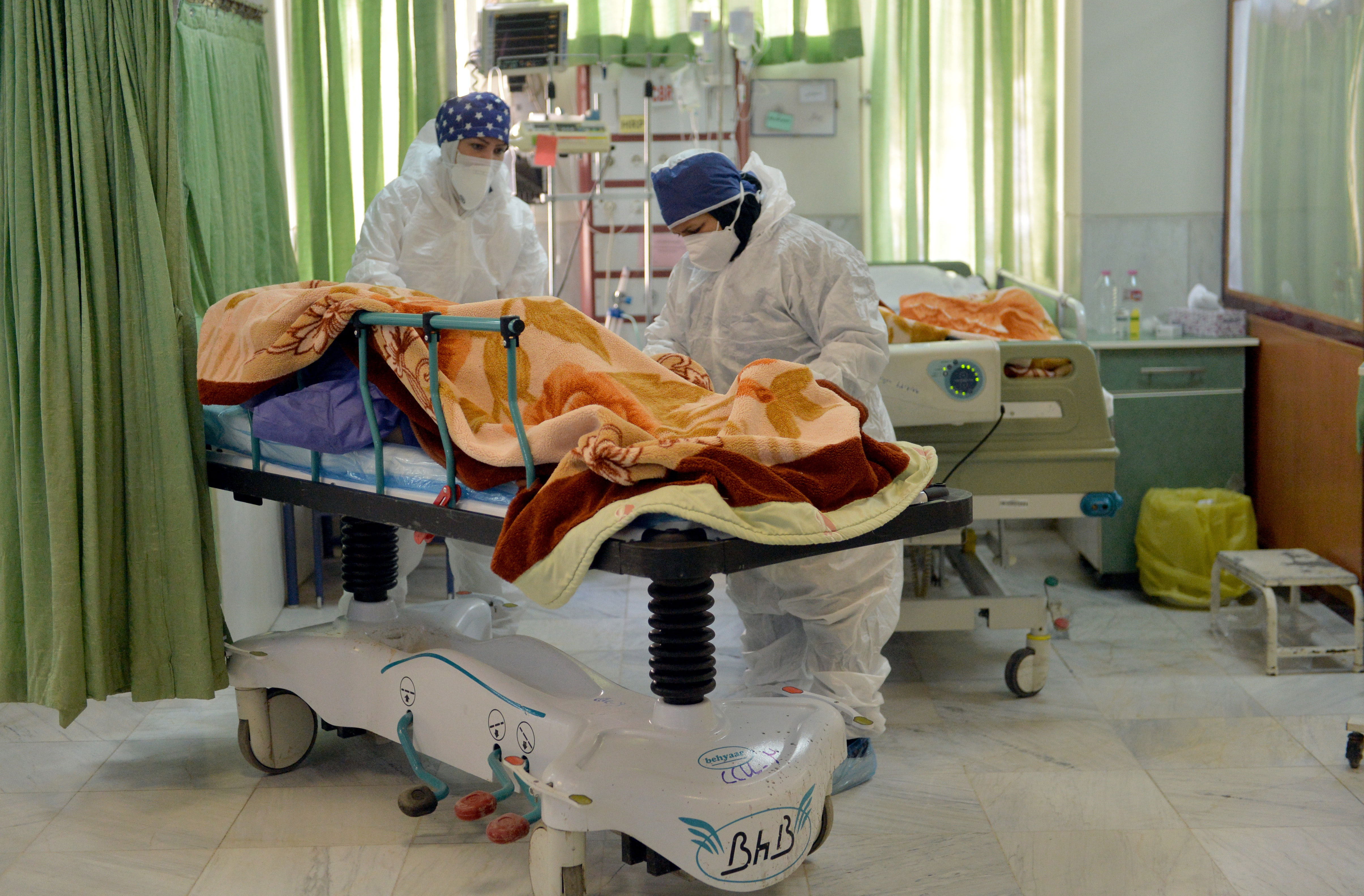 Health care staff take care of Covid-19 patients in an intensive care unit in Tehran in December.