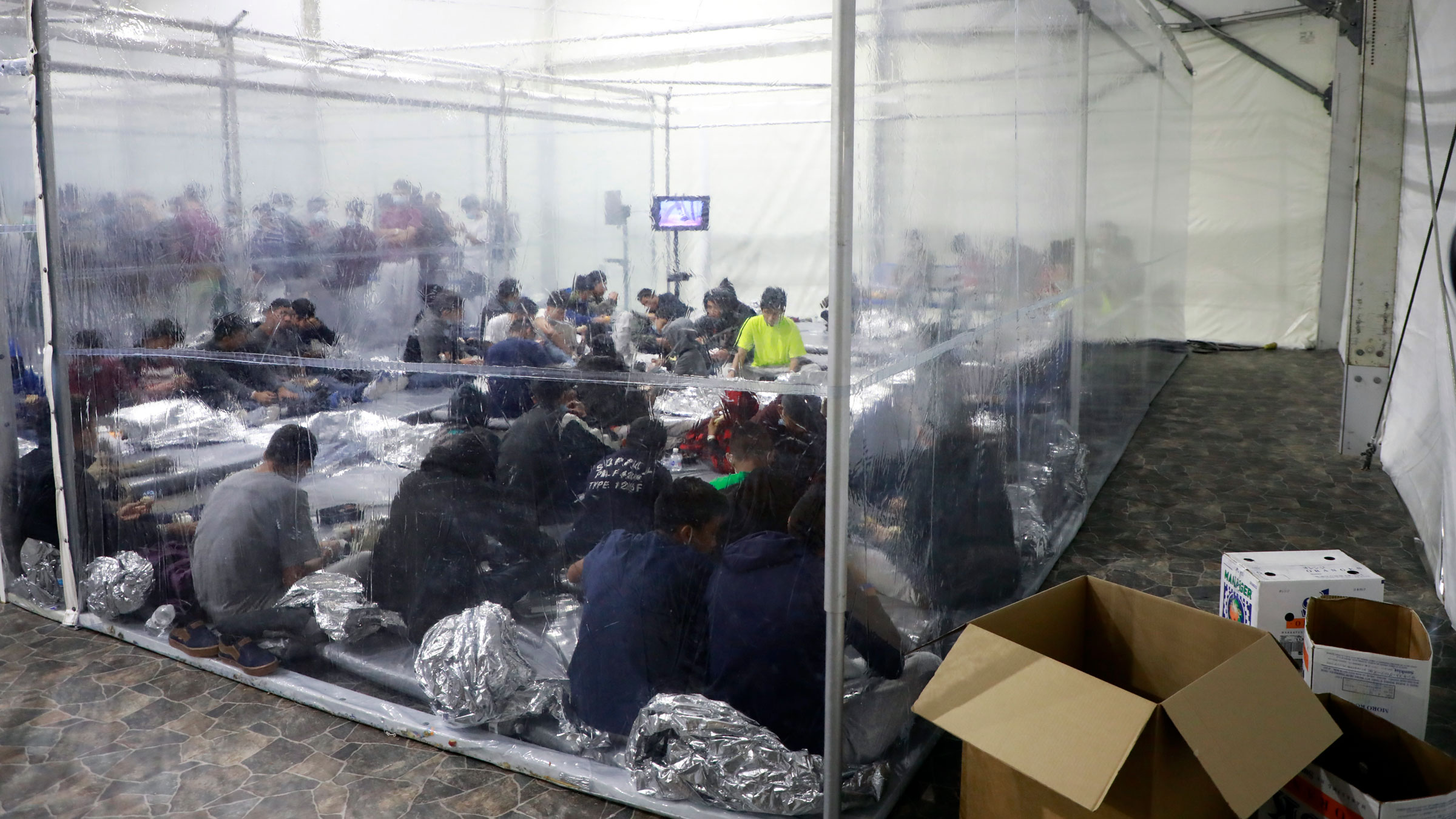Migrants are detained at a temporary processing facility in Donna, Texas, in March.