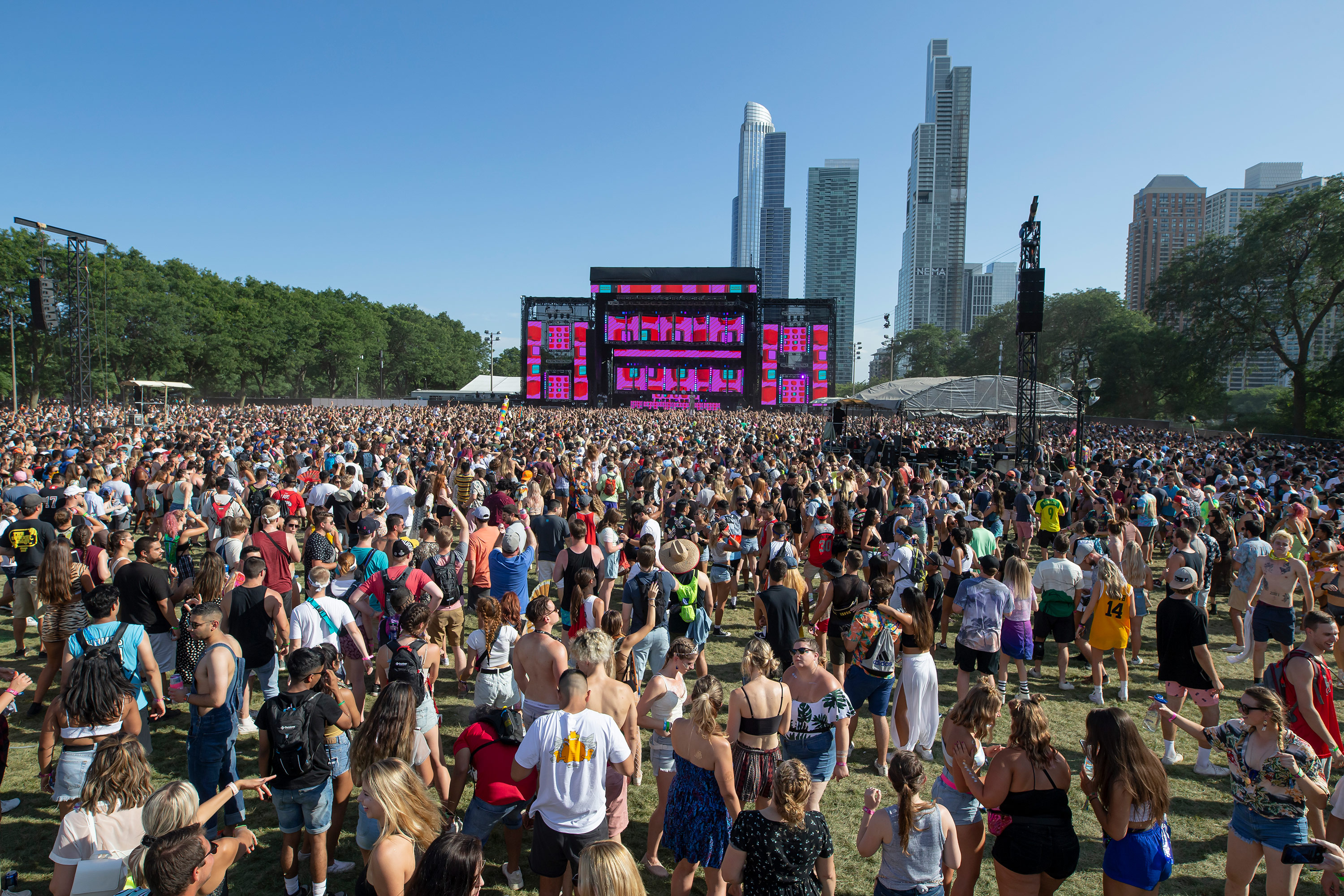 Festival goers attend Lollapalooza at Grant Park in Chicago, in 2019.