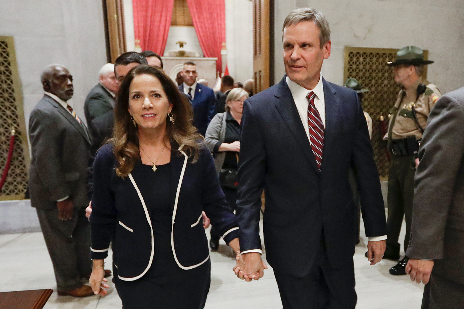 Tennessee Gov. Bill Lee, center, and his wife, Maria, leave the House Chamber after Lee gave his State of the State Address in Nashville, on February 3.