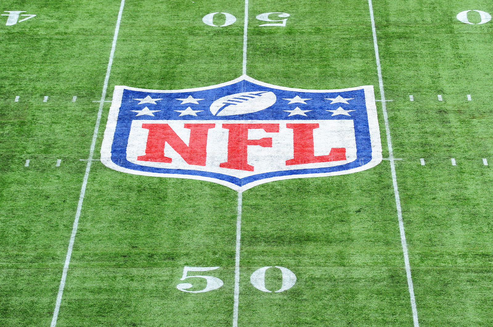 The NFL logo is seen on the field before a game between the Carolina Panthers and Tampa Bay Buccaneers in London on October 13, 2019.