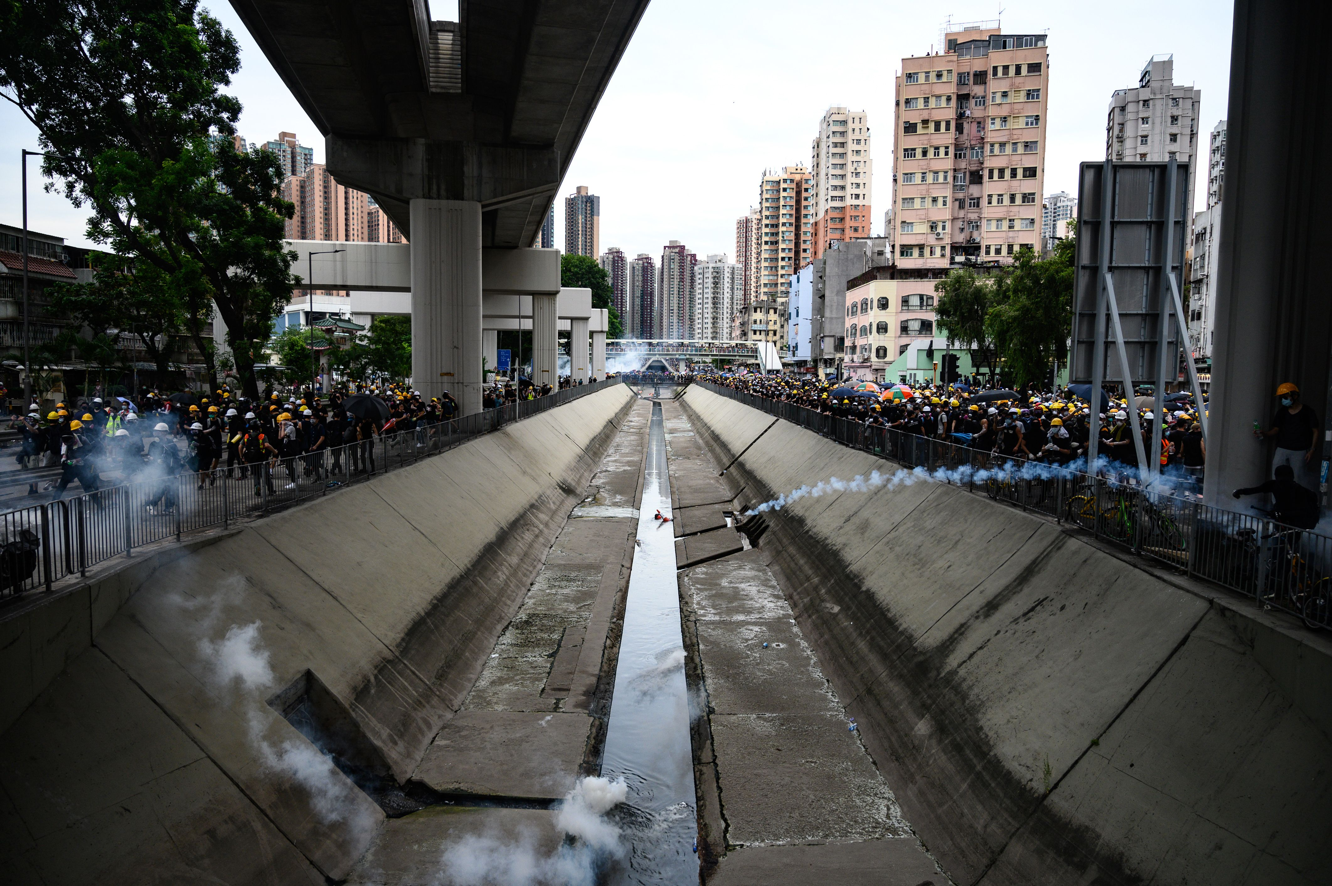 Hong Kong police fire tear gas at protesters during a demonstration in the district of Yuen Long.