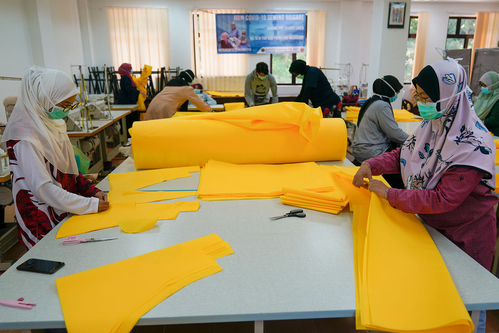 Volunteers construct Personal Protective Equipment to help stop the spread of the coronavirus being made at the International Islamic University Malaysia in Gombak, outside Kuala Lumpur, Malaysia, on April 10.