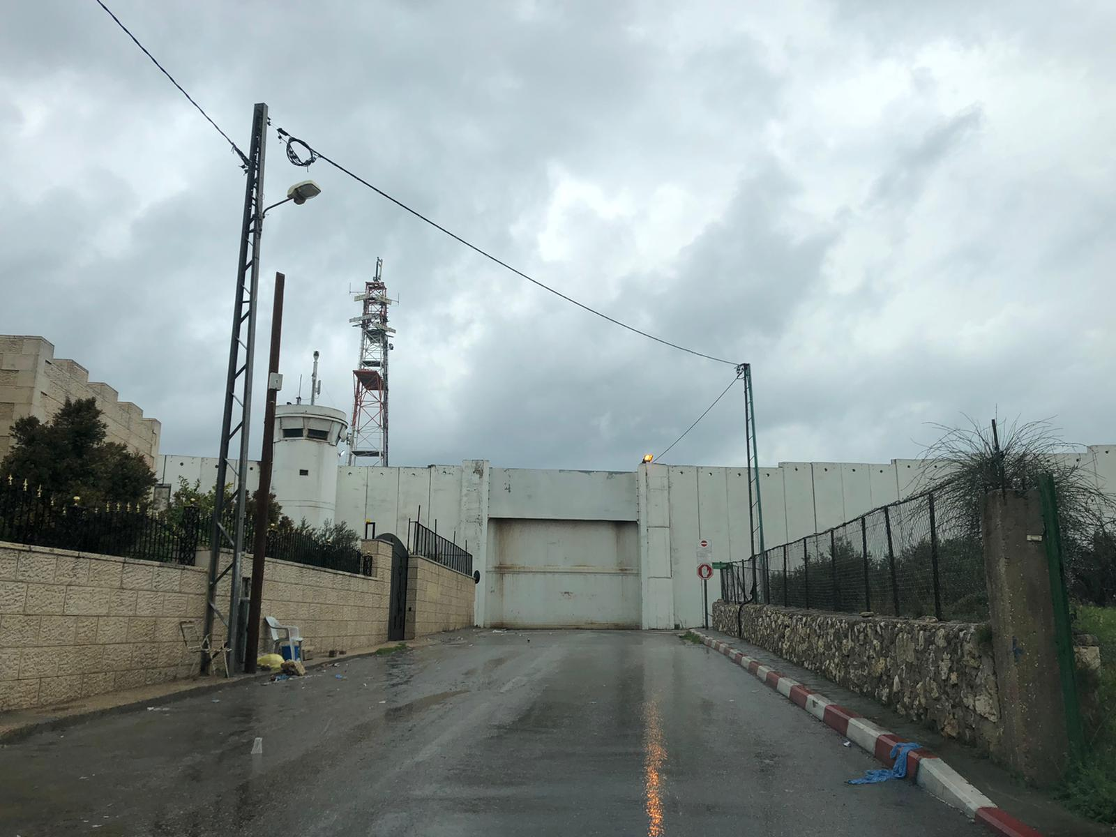 The imposing metal gate at Checkpoint 300, the main crossing point between Bethlehem and Jerusalem, is locked shut.