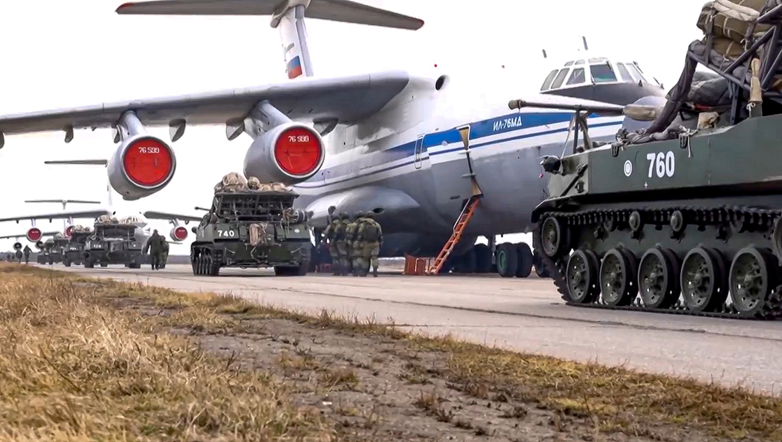 Russian military vehicles prepare to be loaded into a plane for airborne drills during maneuvers in Crimea.