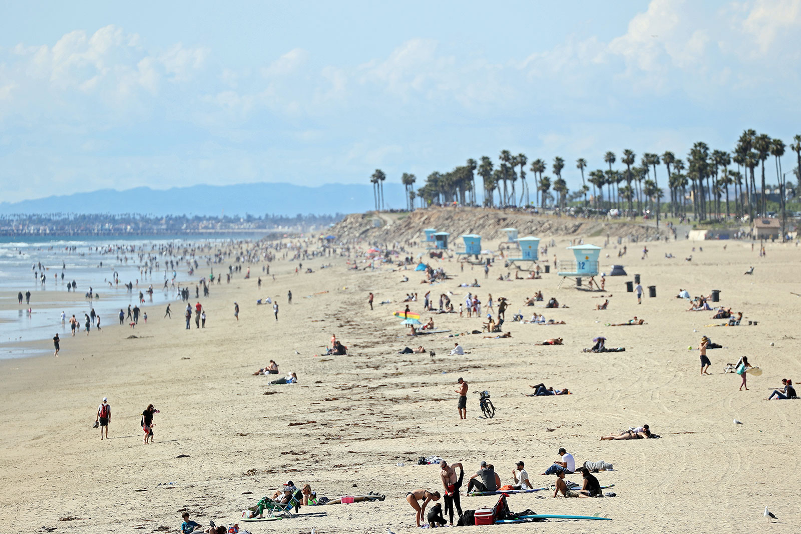 People visit the beach in Huntington Beach, California, on March 21.