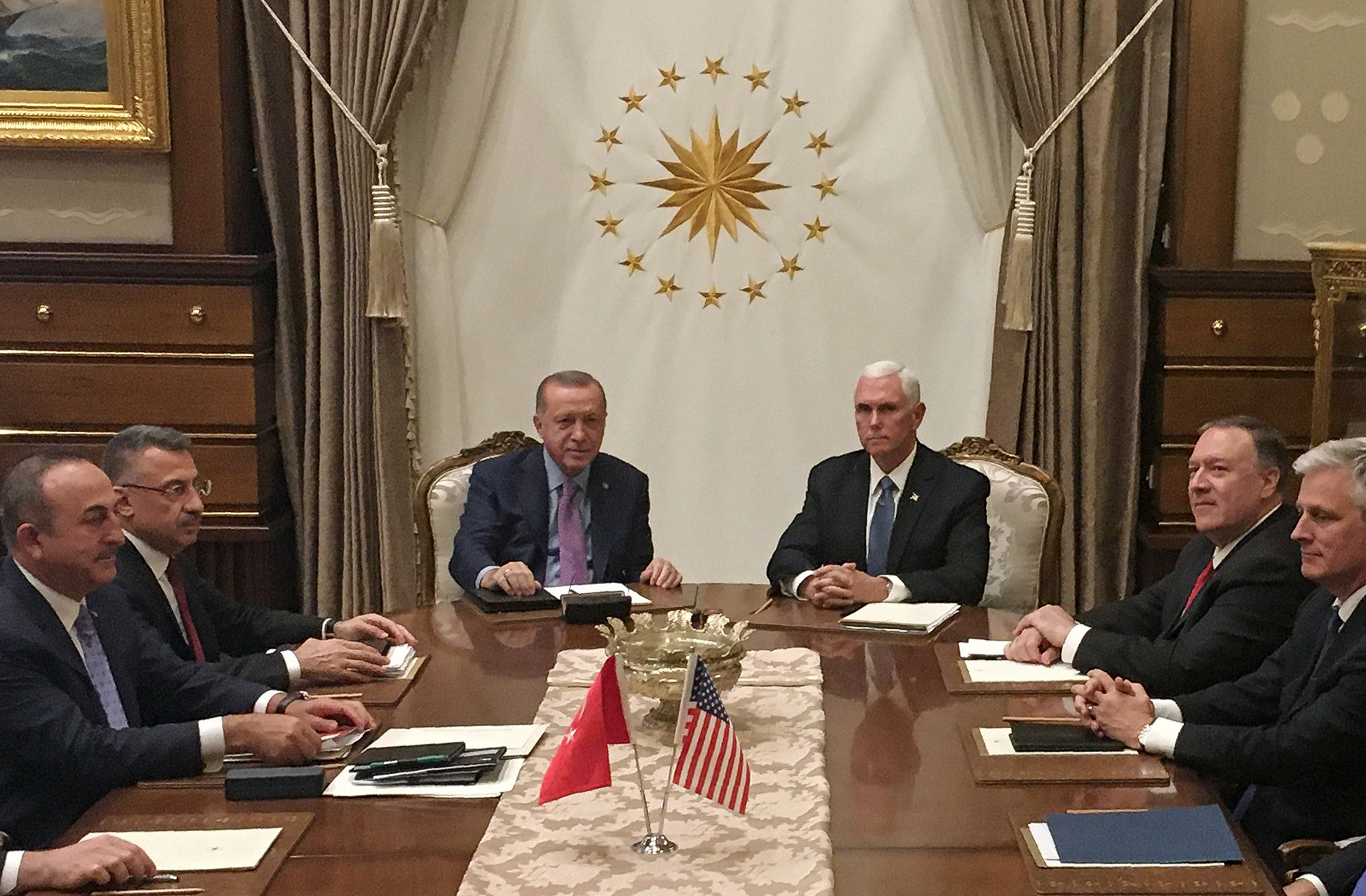 Turkish President Recep Tayyip Erdogan (C-L) and Vice President Mike Pence (C-R), joined by Secretary of State Mike Pompeo (4R), Turkish Vice President Fuat Oktay (4L), Turkish Foreign Minister Mevlut Cavusoglu (3L) and senior aides meet at the presidential complex in Ankara, Turkey, on Oct.17, 2019.