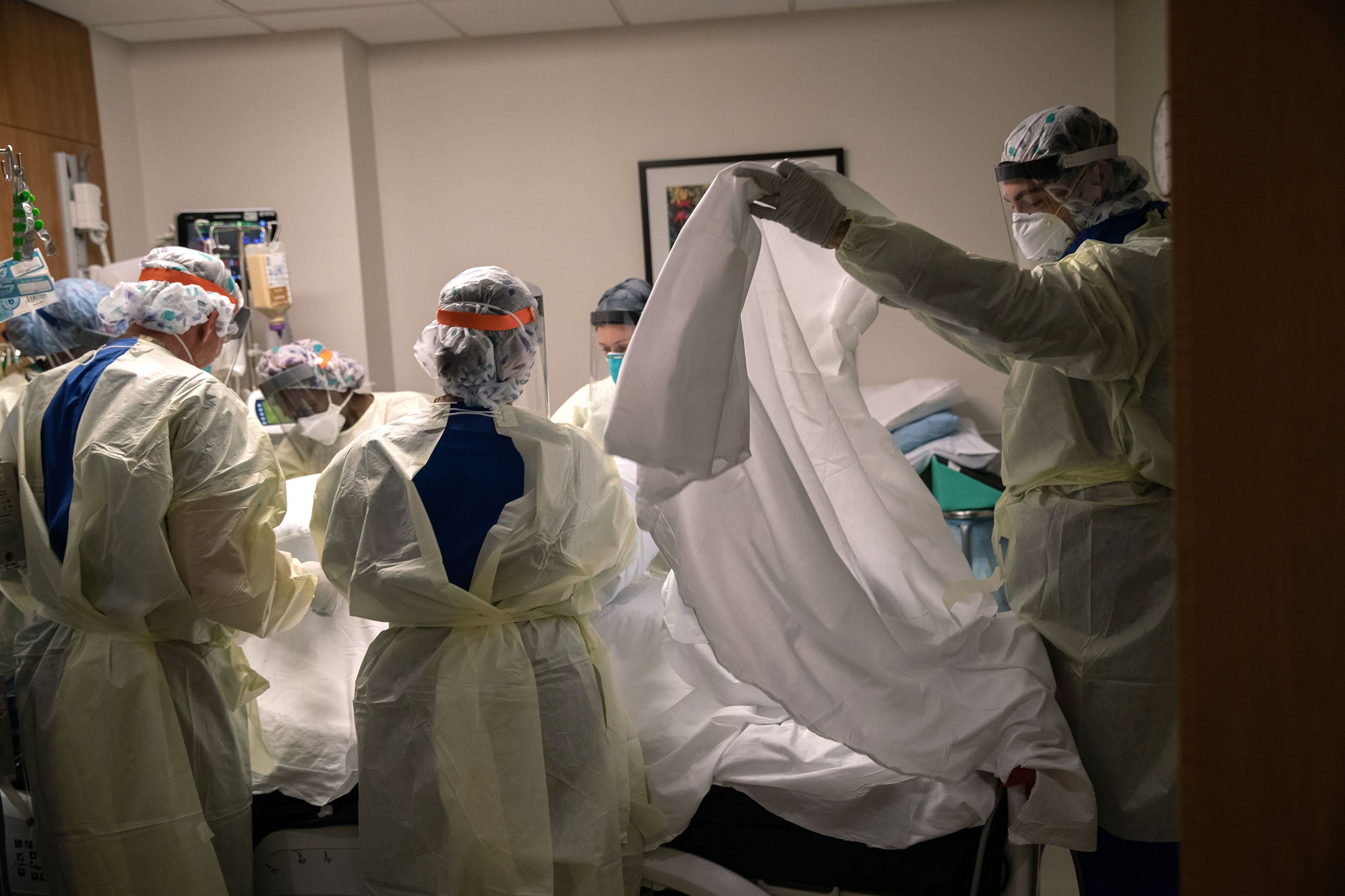 Medical workers tend to a coronavirus patient at Stamford Hospital on April 24 in Stamford, Connecticut.
