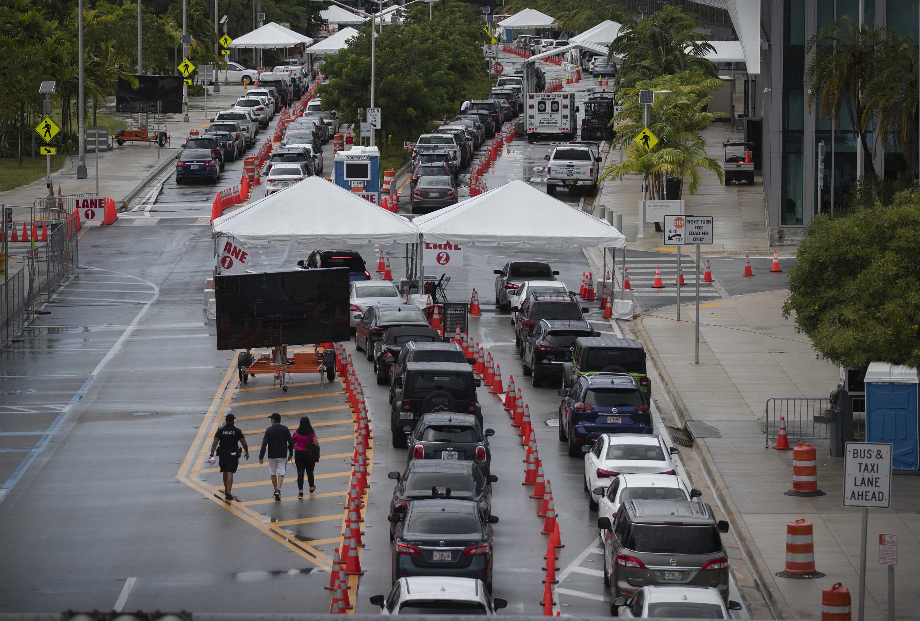 Cars line up as drivers wait to be tested for Covid-19 at the Miami Beach convention center on Monday.