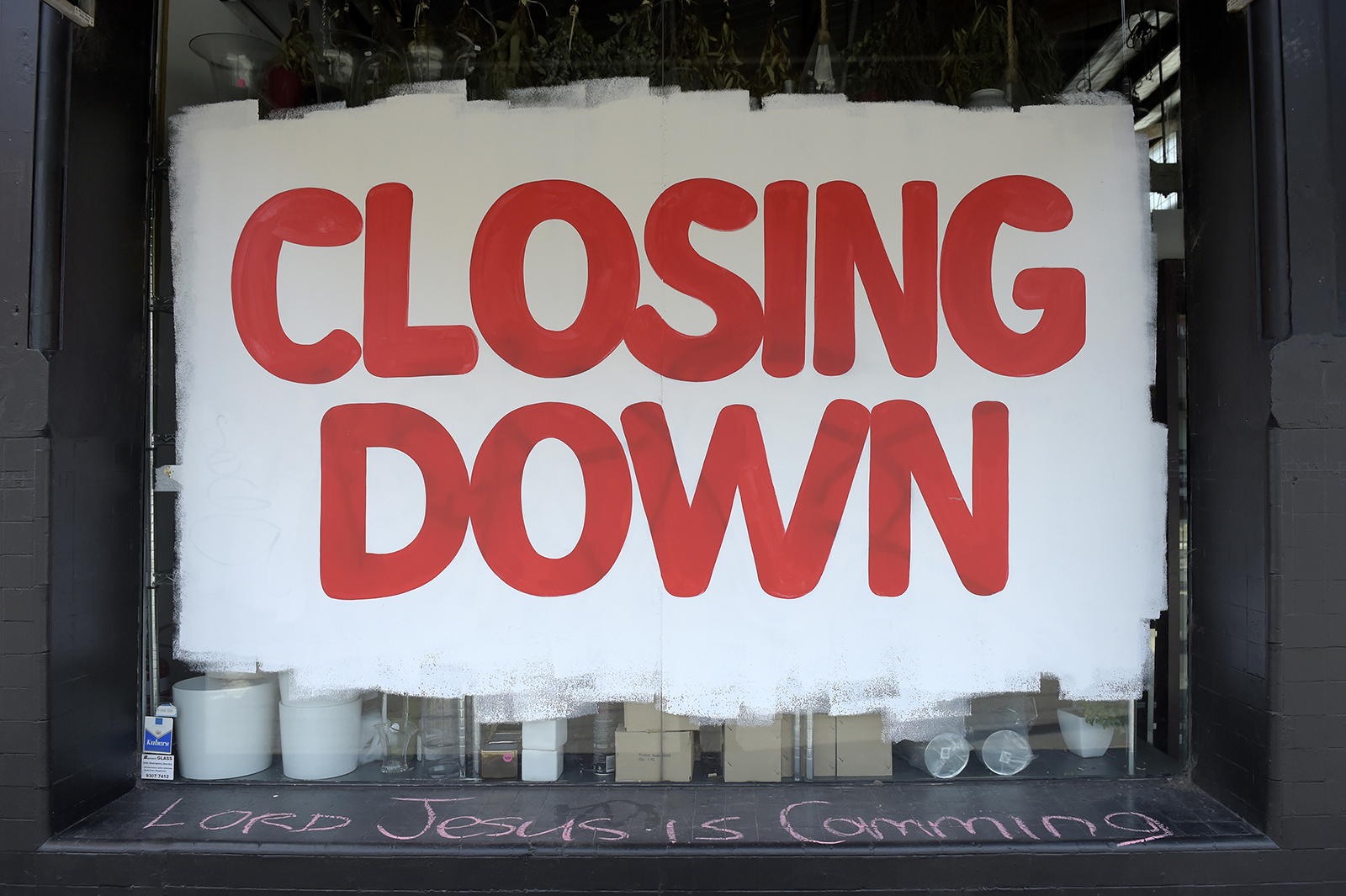 A 'closing down' sign fills the window of a homewares store in Melbourne, Australia, on September 1.