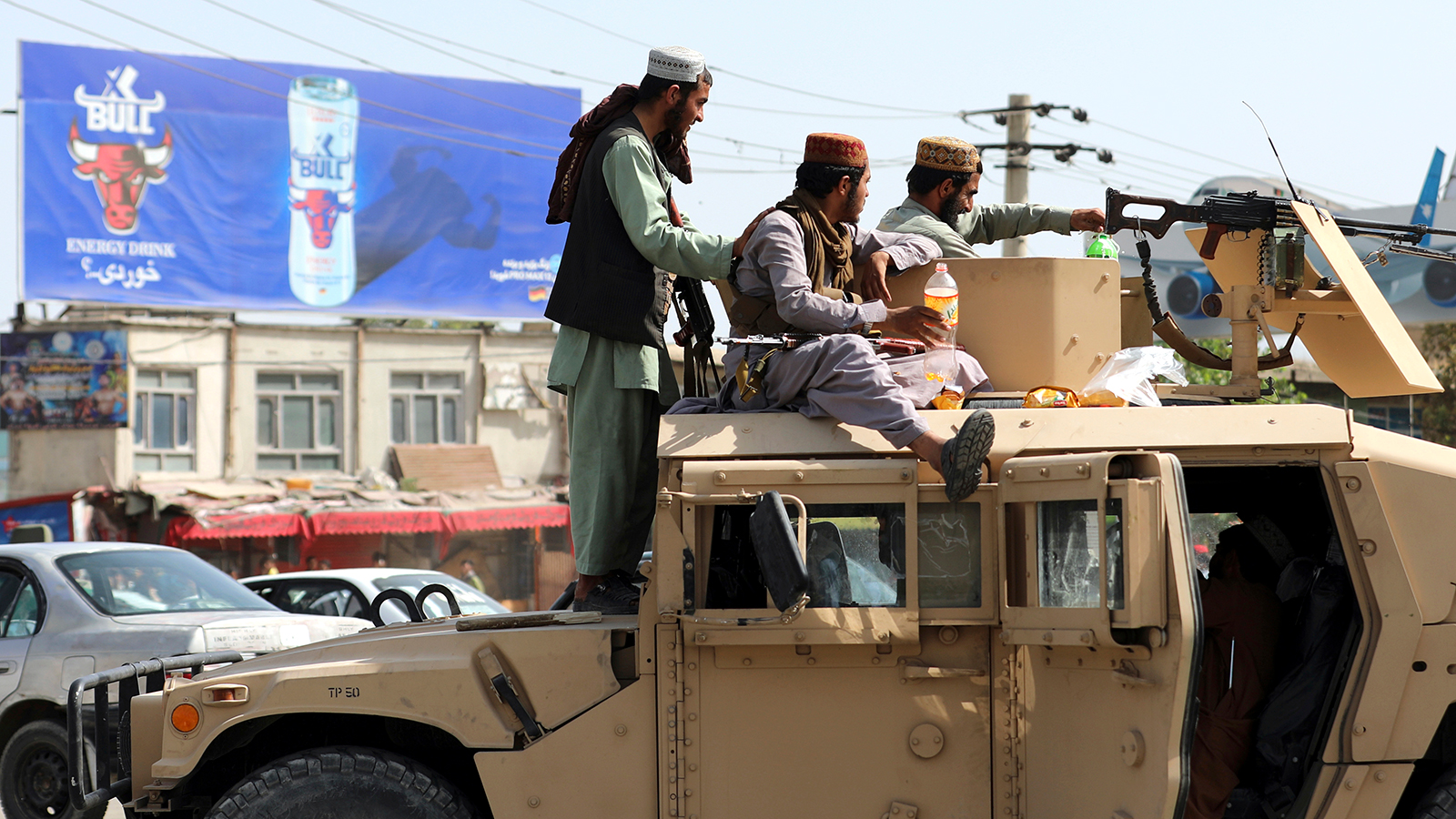 Taliban fighters stand guard in front of the Hamid Karzai International Airport, in Kabul, Afghanistan, on August 16.