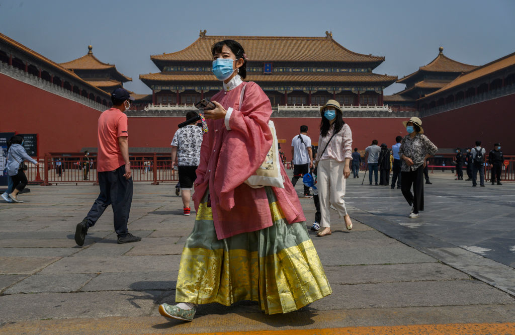 A Chinese tourist wears a face mask in Beijing's Forbidden City on May 1.