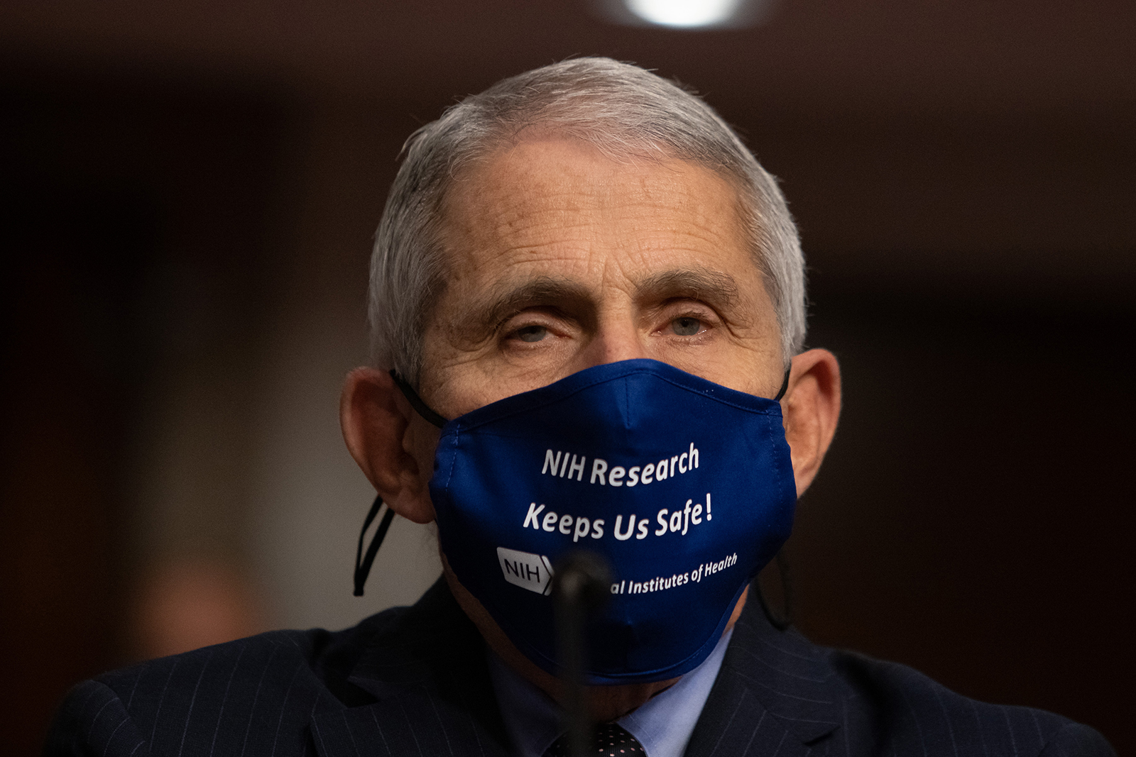 Anthony Fauci, director of National Institute of Allergy and Infectious Diseases at NIH, looks on before testifying at a Senate Health, Education, and Labor and Pensions Committee on Capitol Hill, on September 23 in Washington.