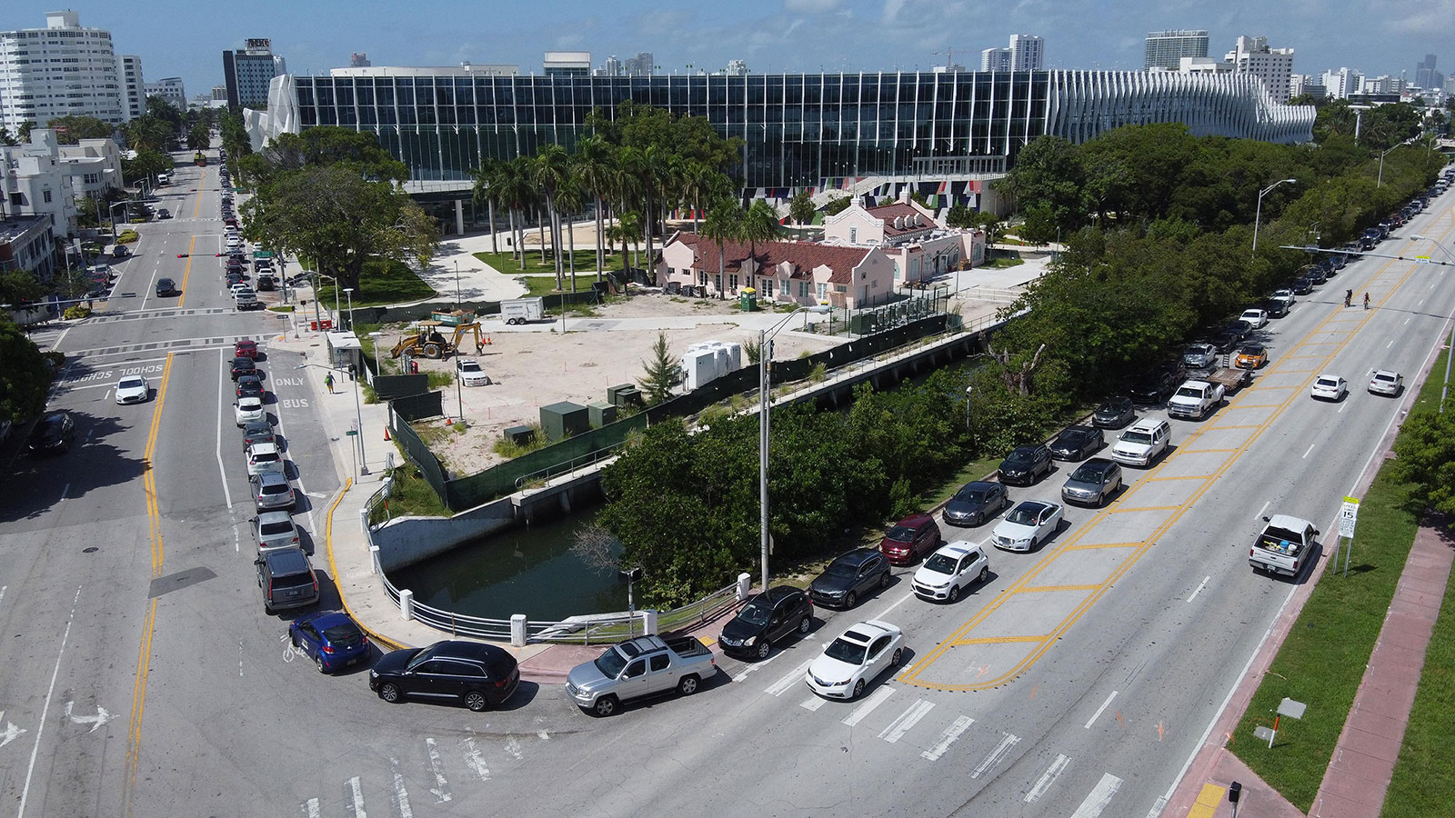 A long line of cars wait to enter a drive-through coronavirus testing site near the Miami Beach Convention Center on Thursday, June 25.
