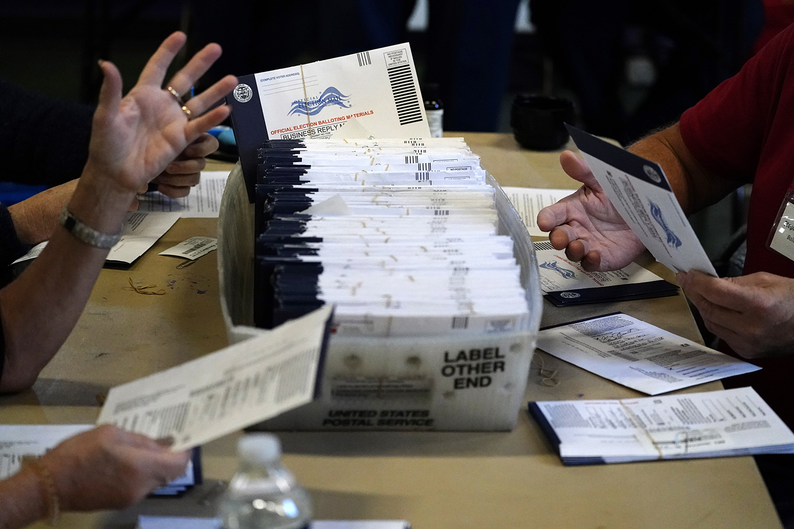 Chester County election workers process mail-in and absentee ballots for the 2020 general election in the United States at West Chester University on Wedensday, November 4, in Pennsylvania.