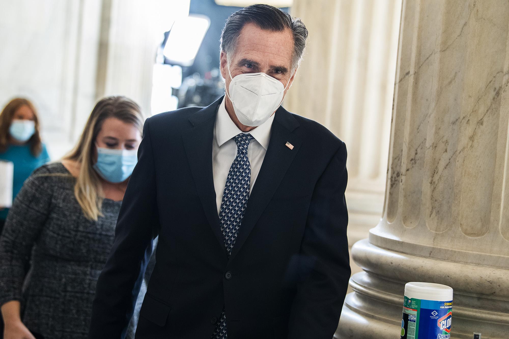 Sen. Mitt Romney, R-Utah, walks in the Russell Building on Capitol Hill in Washington DC, on Tuesday, December 15.
