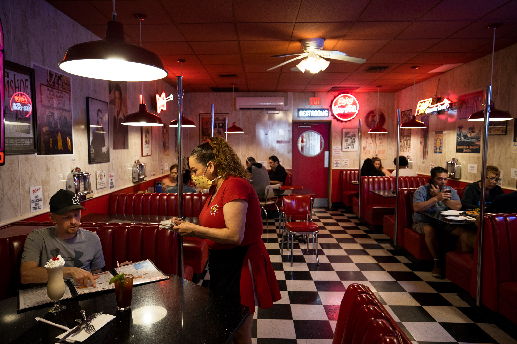 People eat at the Busy Bee Diner on May 24 in Ventura, California.