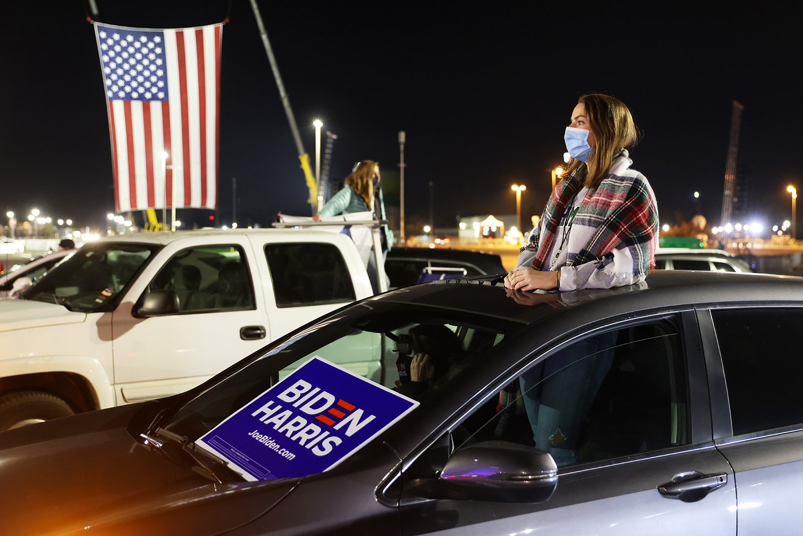 A supporter attends a drive-in election night event for Democratic presidential nominee Joe Biden at the Chase Center.