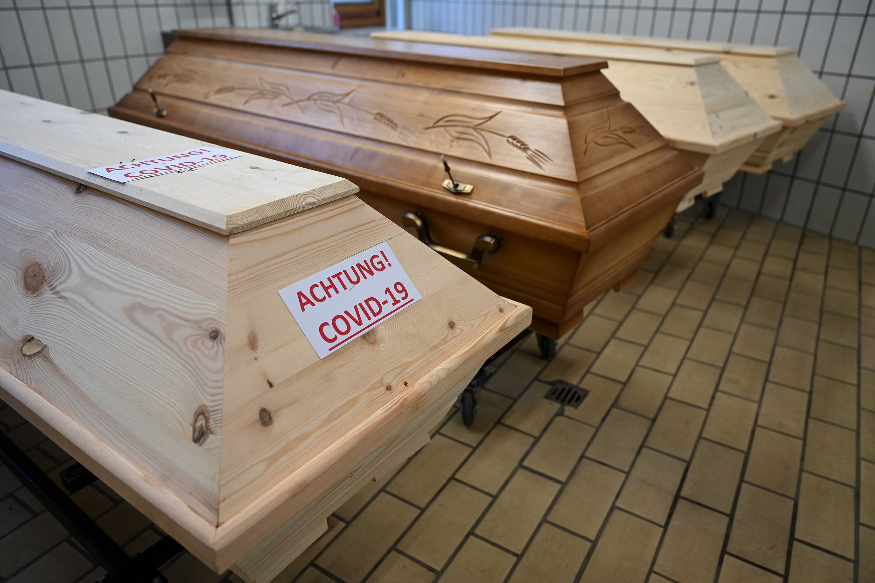 """A coffin labeled with the inscription """"Attention! Covid-19"""" is pictured at a crematorium in Tuttlingen, Germany, on February 4."""