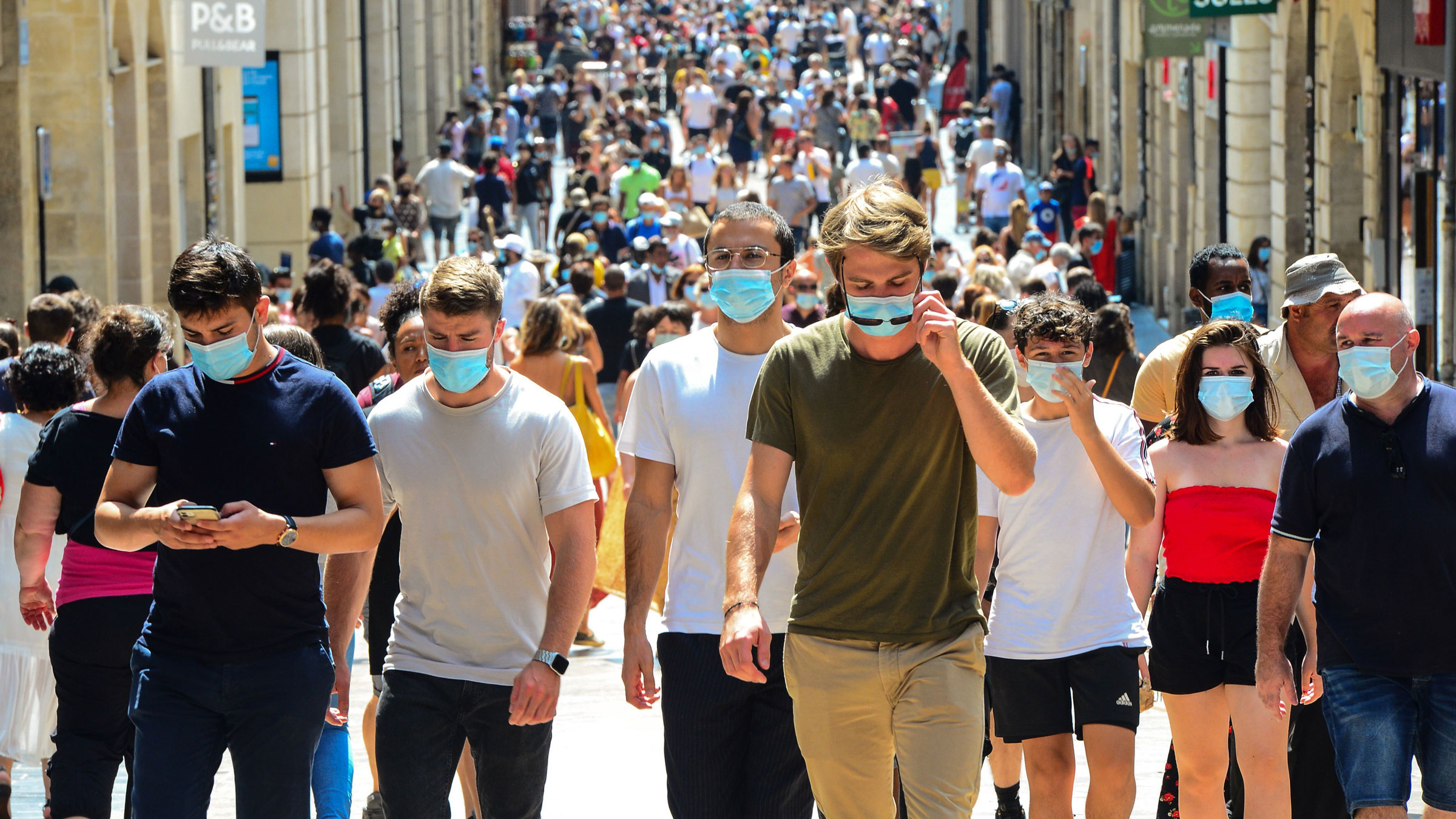 People walk on Sainte-Catherine, a main shopping street in Bordeaux, France, where wearing a mask was compulsory as of Saturday.