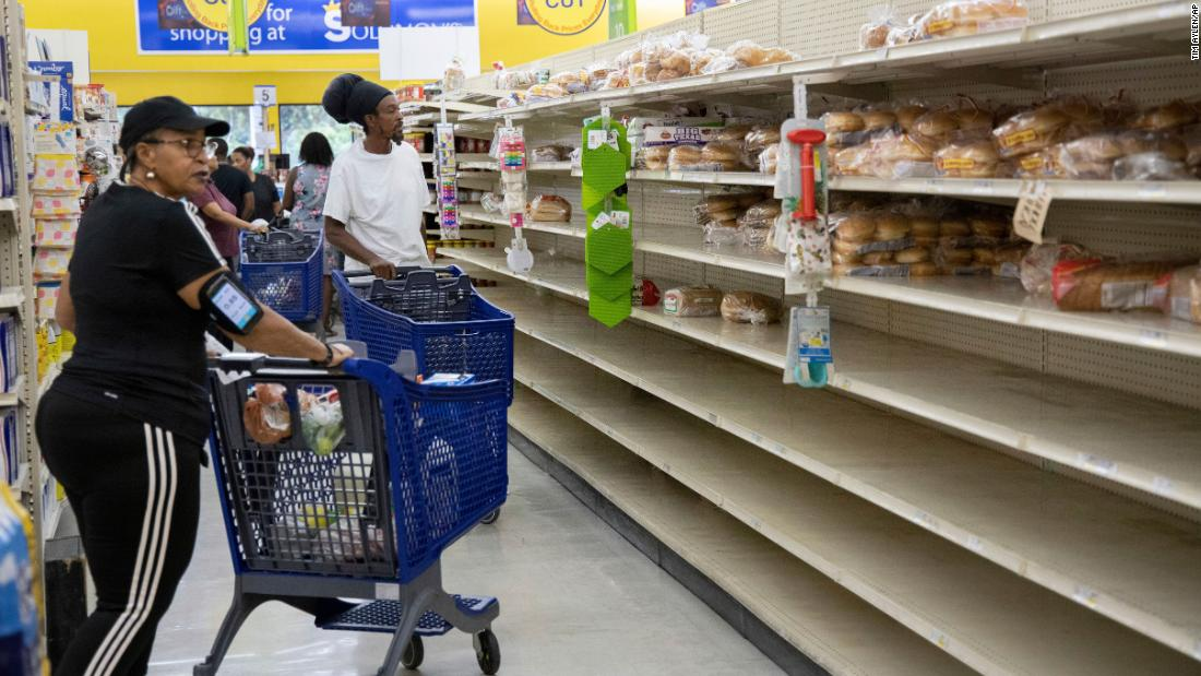 People shop for supplies before the arrival of Hurricane Dorian, in Freeport, Bahamas, Friday, Aug. 30. Tim Aylen/AP