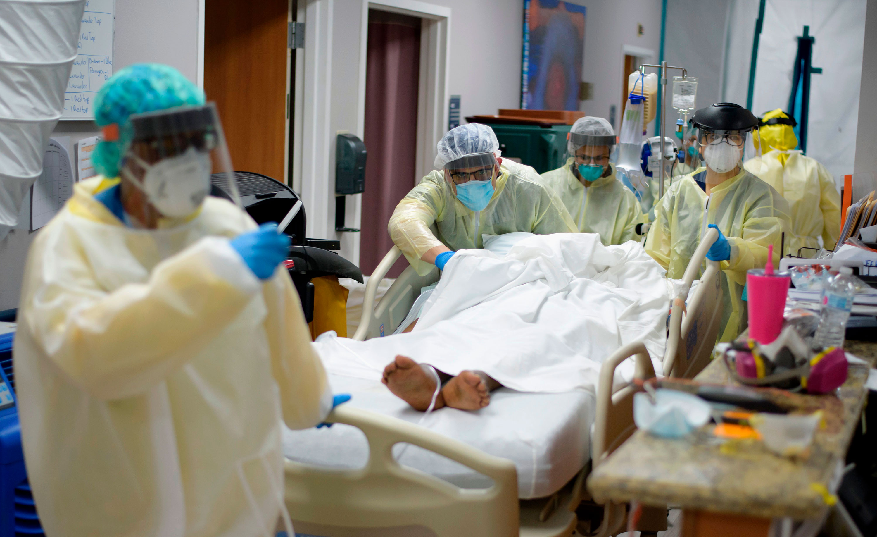Healthcare workers move a patient in the Covid-19 Unit at United Memorial Medical Center in Houston, Texas, on July 2