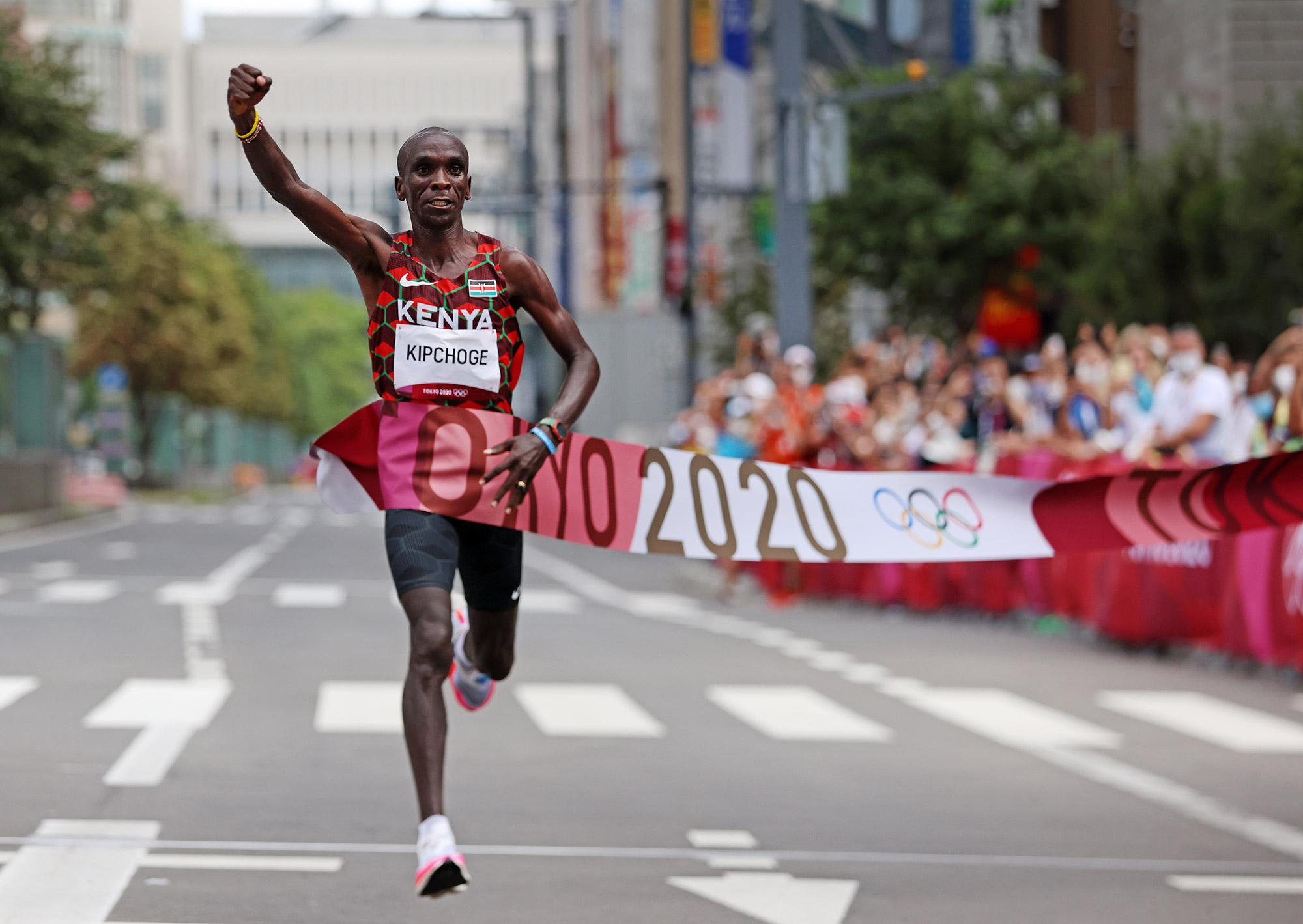 Kenya's Eliud Kipchoge crosses the finish line during the marathon final on Sunday.